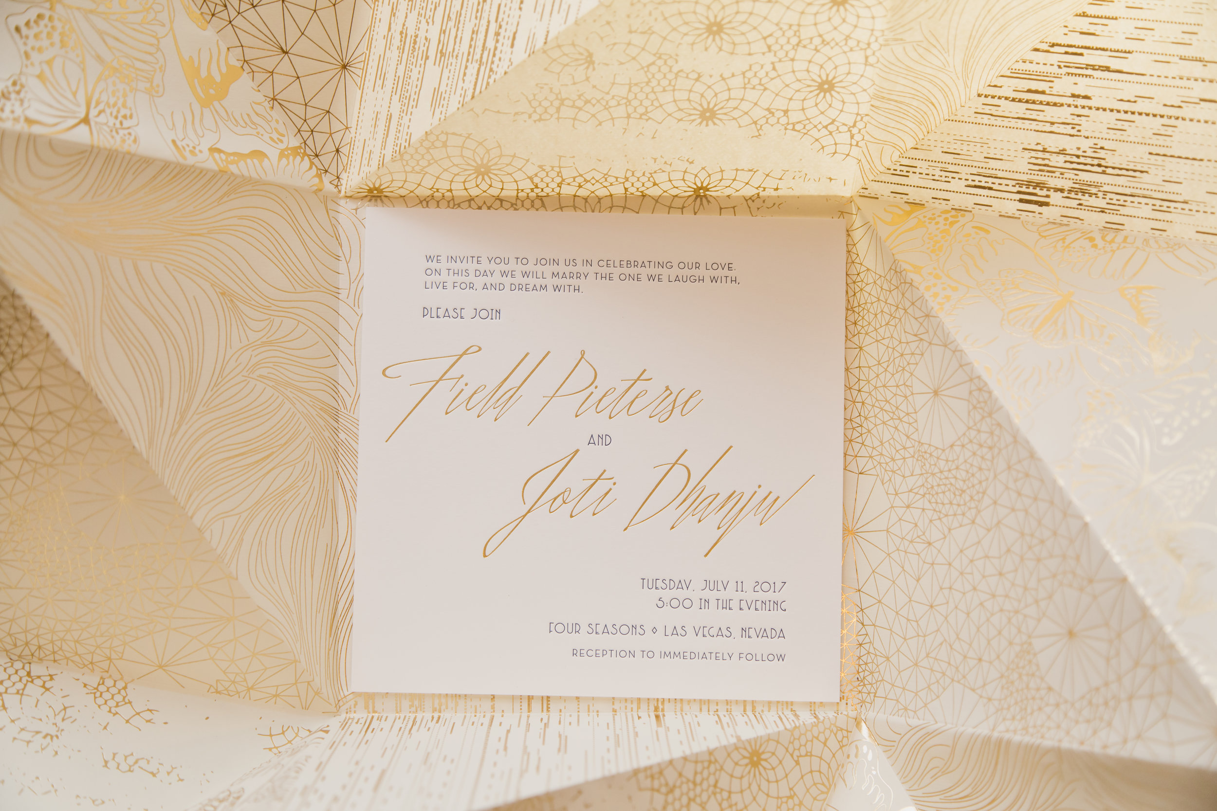 Oragami invitations by Ceci New York.Destination Wedding Planner  Andrea Eppolito ·Photos by  Adam Frazier Photography ·Floral and Decor by  Destinations by Design · Lighting by  LED Unplugged ·Venue · Invitations  Ceci New York  · Menus by  Alligator Soup