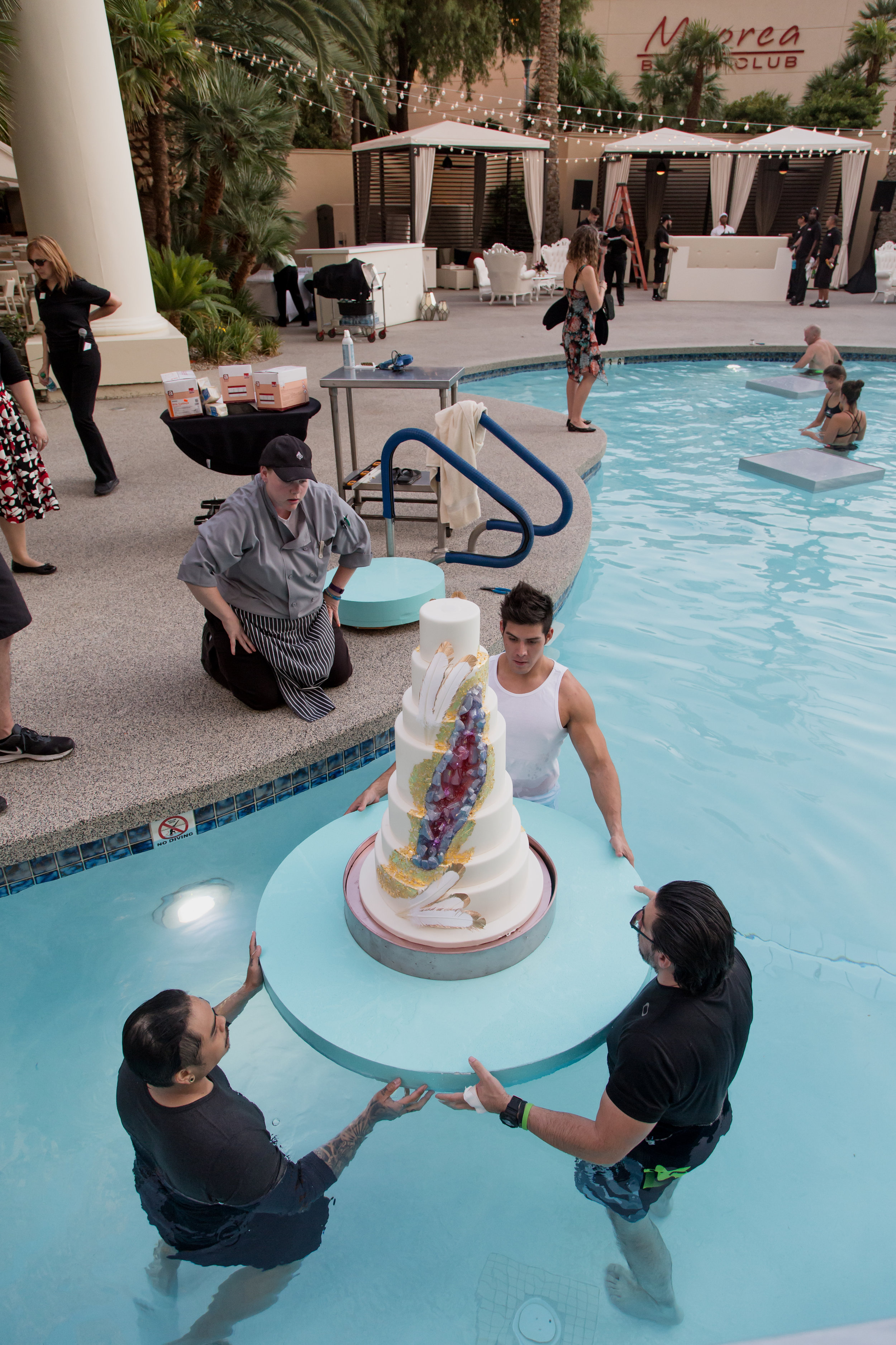 Behind the Scenes - How do you float a wedding cake?Destination Wedding Planner  Andrea Eppolito ·Photos by  Adam Frazier Photography ·Floral and Decor by  Destinations by Design · Lighting by  LED Unplugged ·Venue · Invitations  Ceci New York  · Menus by  Alligator Soup