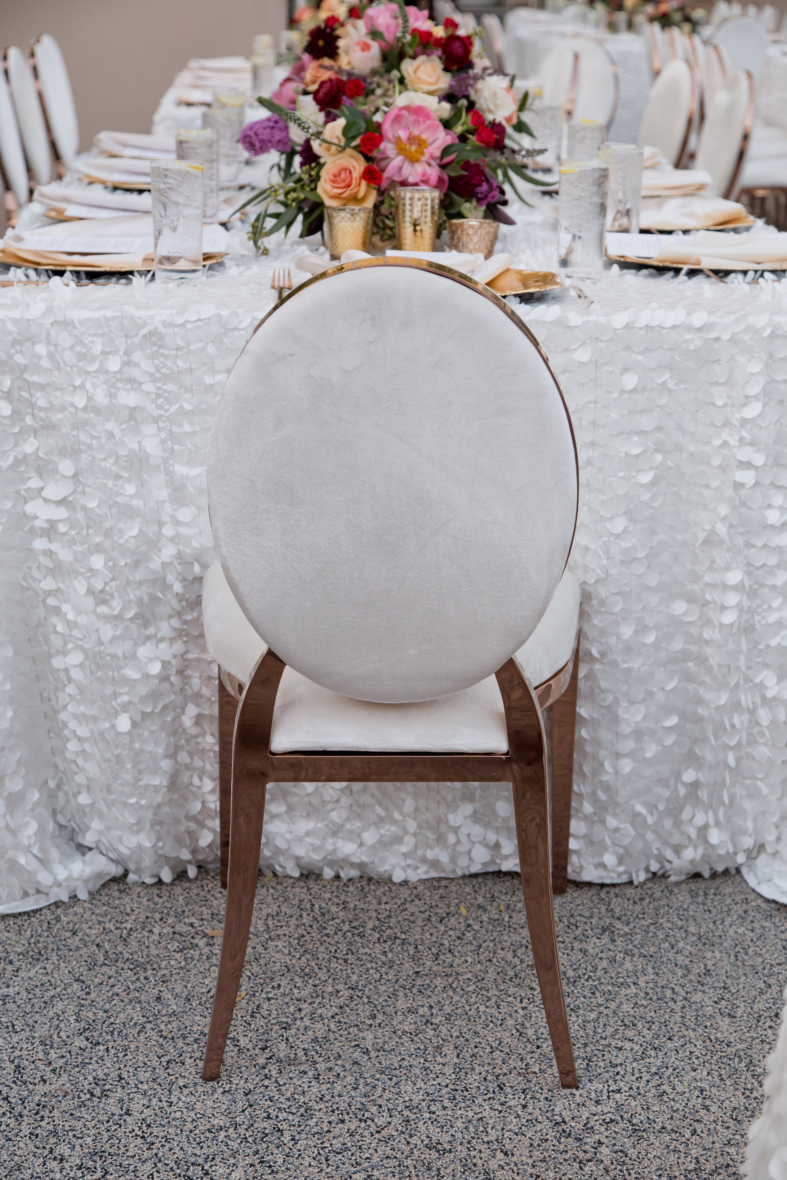 White and gold luxe wedding chair. Destination Wedding Planner  Andrea Eppolito ·Photos by  Adam Frazier Photography ·Floral and Decor by  Destinations by Design · Lighting by  LED Unplugged ·Venue · Invitations  Ceci New York  · Menus by  Alligator Soup