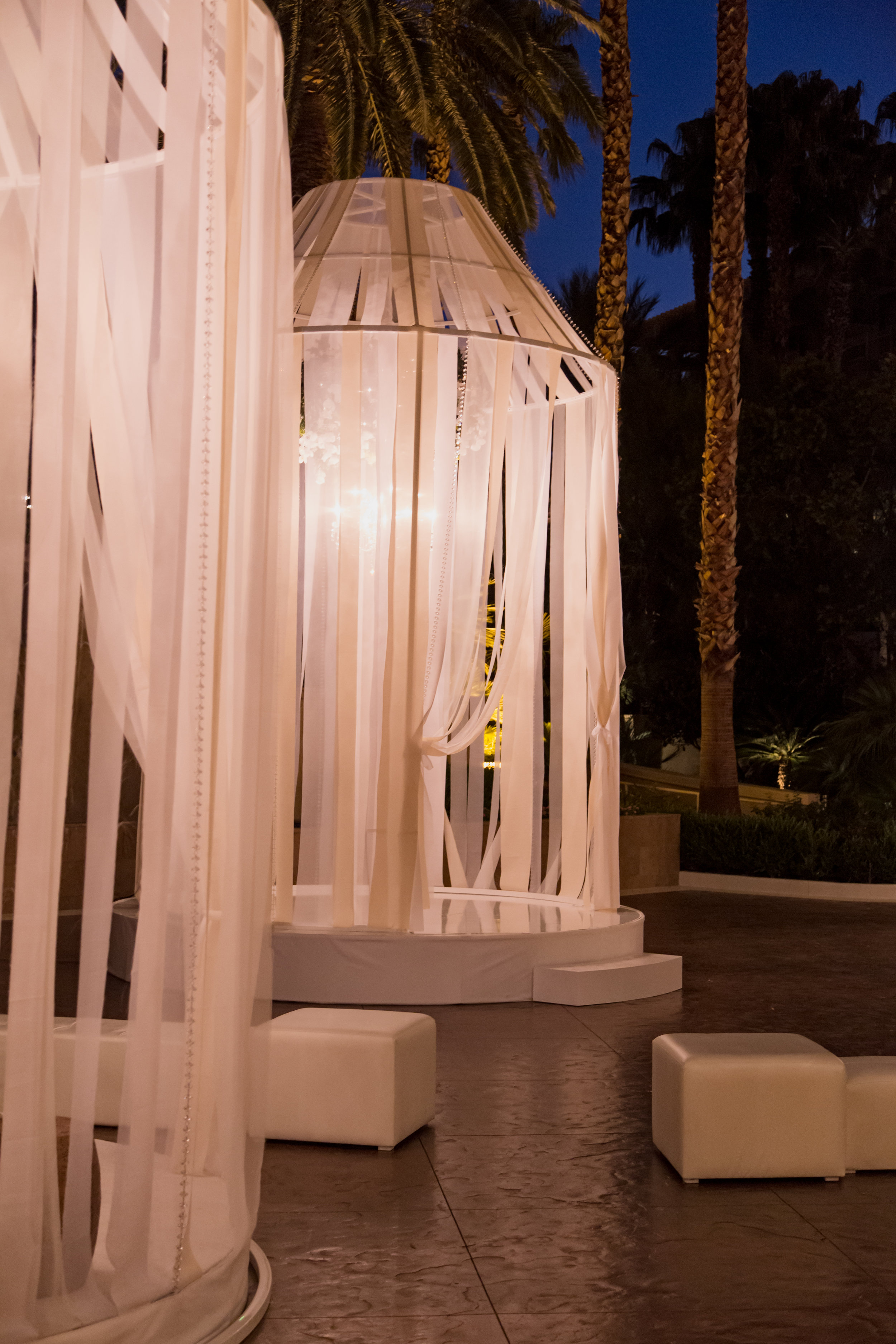 Oversized birdcages lit at night. Destination Wedding Planner  Andrea Eppolito ·Photos by  Adam Frazier Photography ·Floral and Decor by  Destinations by Design · Lighting by  LED Unplugged ·Venue · Invitations  Ceci New York  · Menus by  Alligator Soup