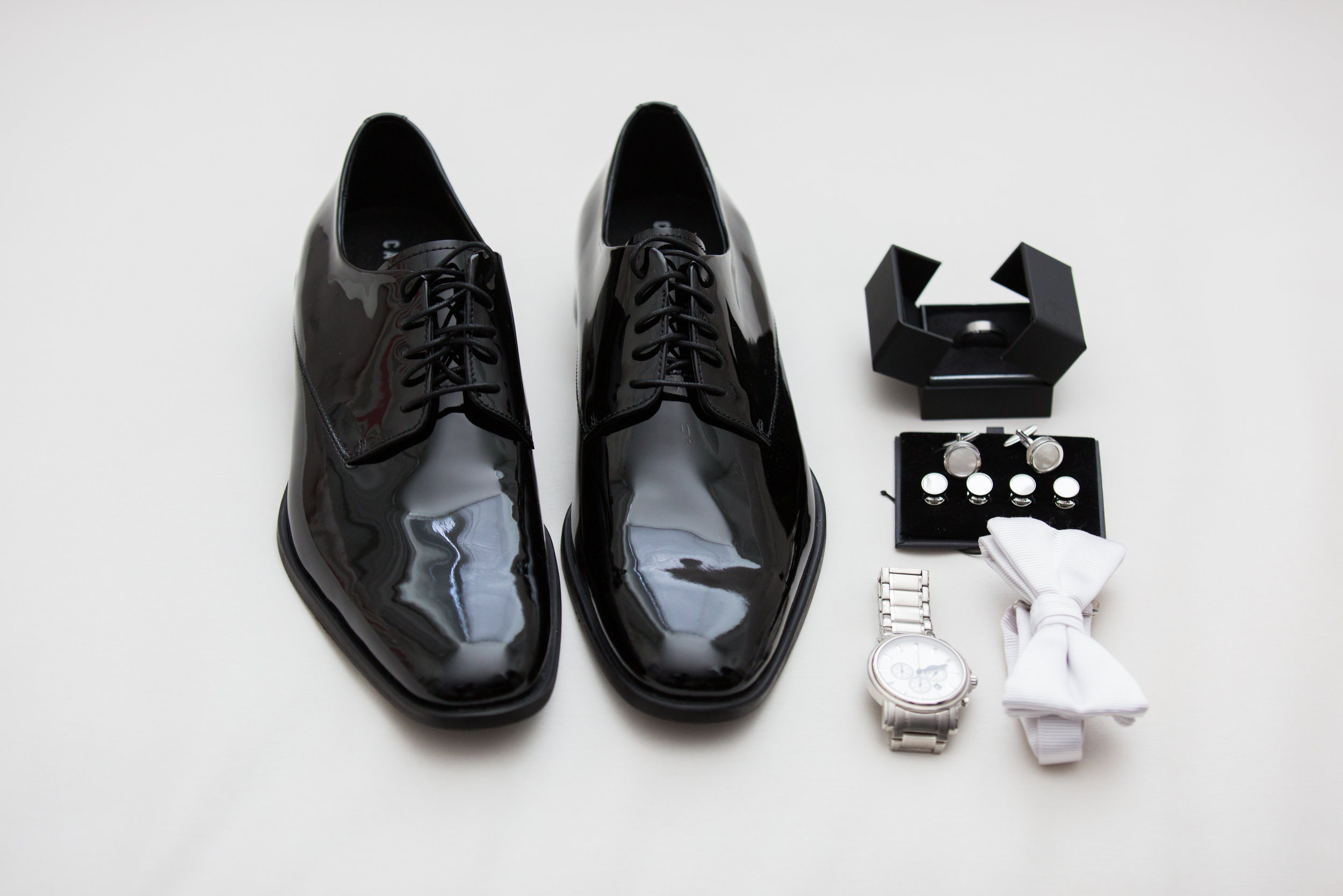 Luxury Destination Wedding Planning and Event Design by  Andrea Eppolito Events  · Photos by  Stephen Salazar  · Groom's Accessories.  Black high shine shoes.  Bow tie.  Watch