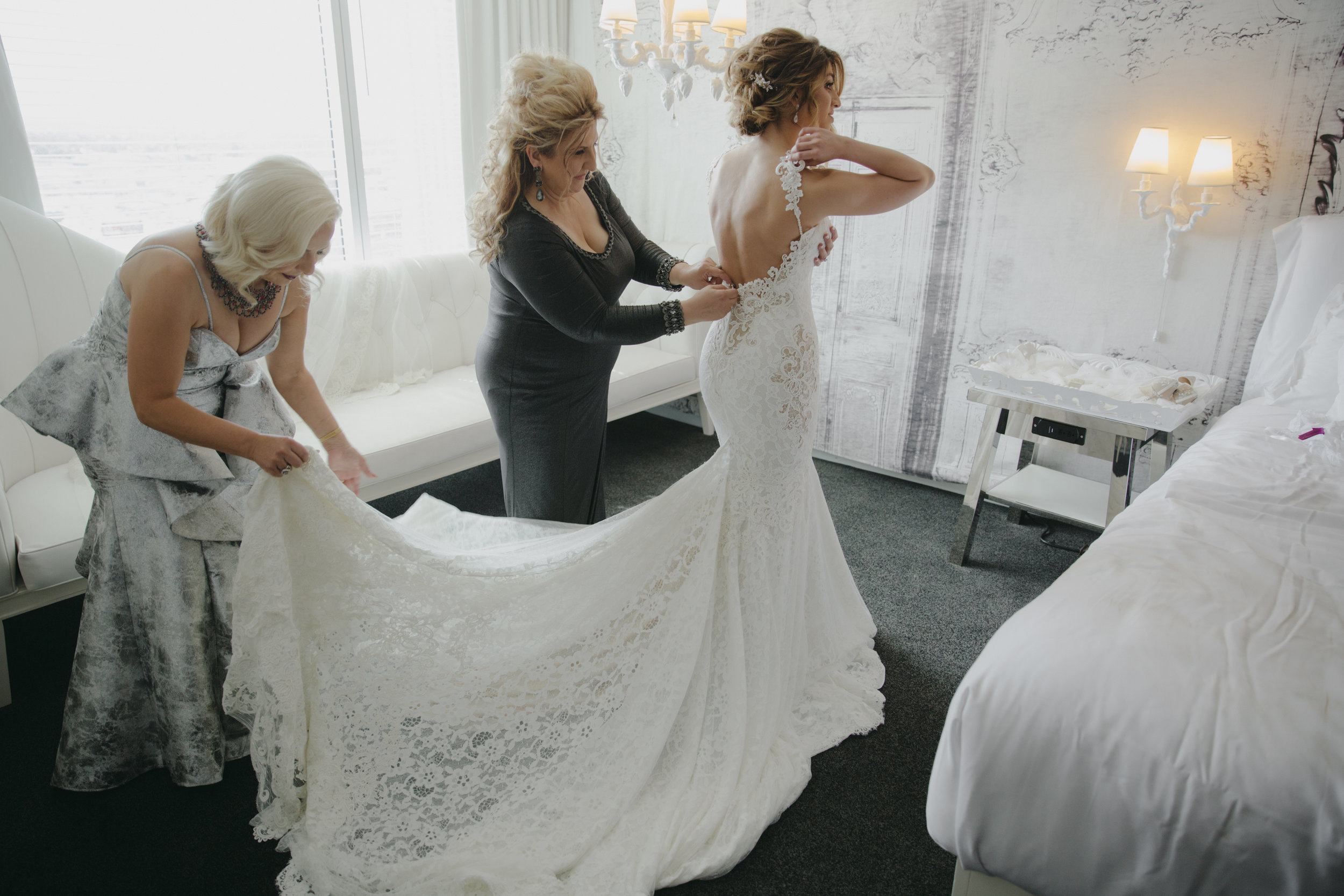 Luxury Destination Wedding Planning and Event Design by  Andrea Eppolito Events  · Photos by  Stephen Salazar  · Bride getting dressed.