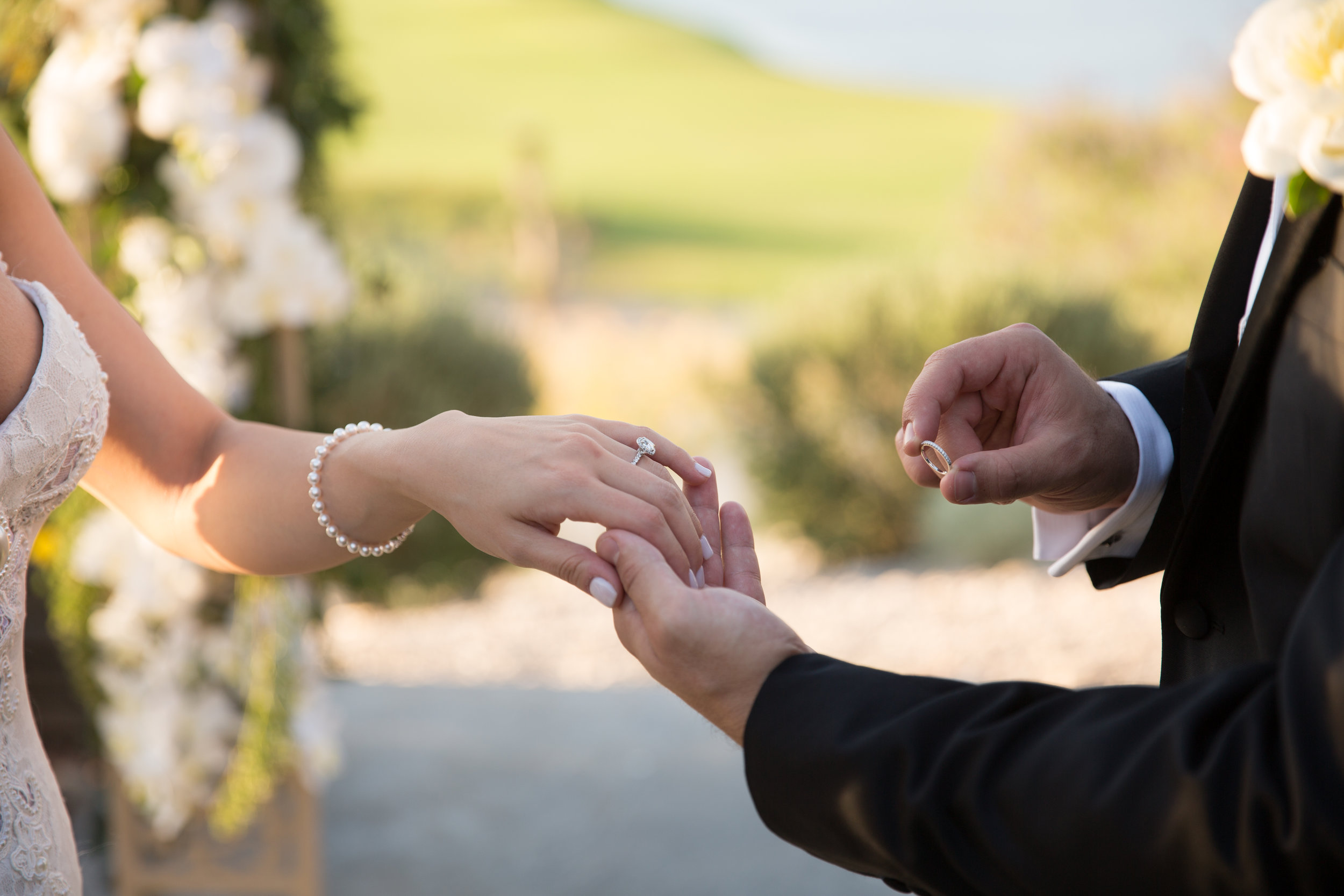 Exchanging wedding rings.  Luxury Destination Wedding Planning and Event Design by  Andrea Eppolito Events  · Photos by  Stephen Salazar
