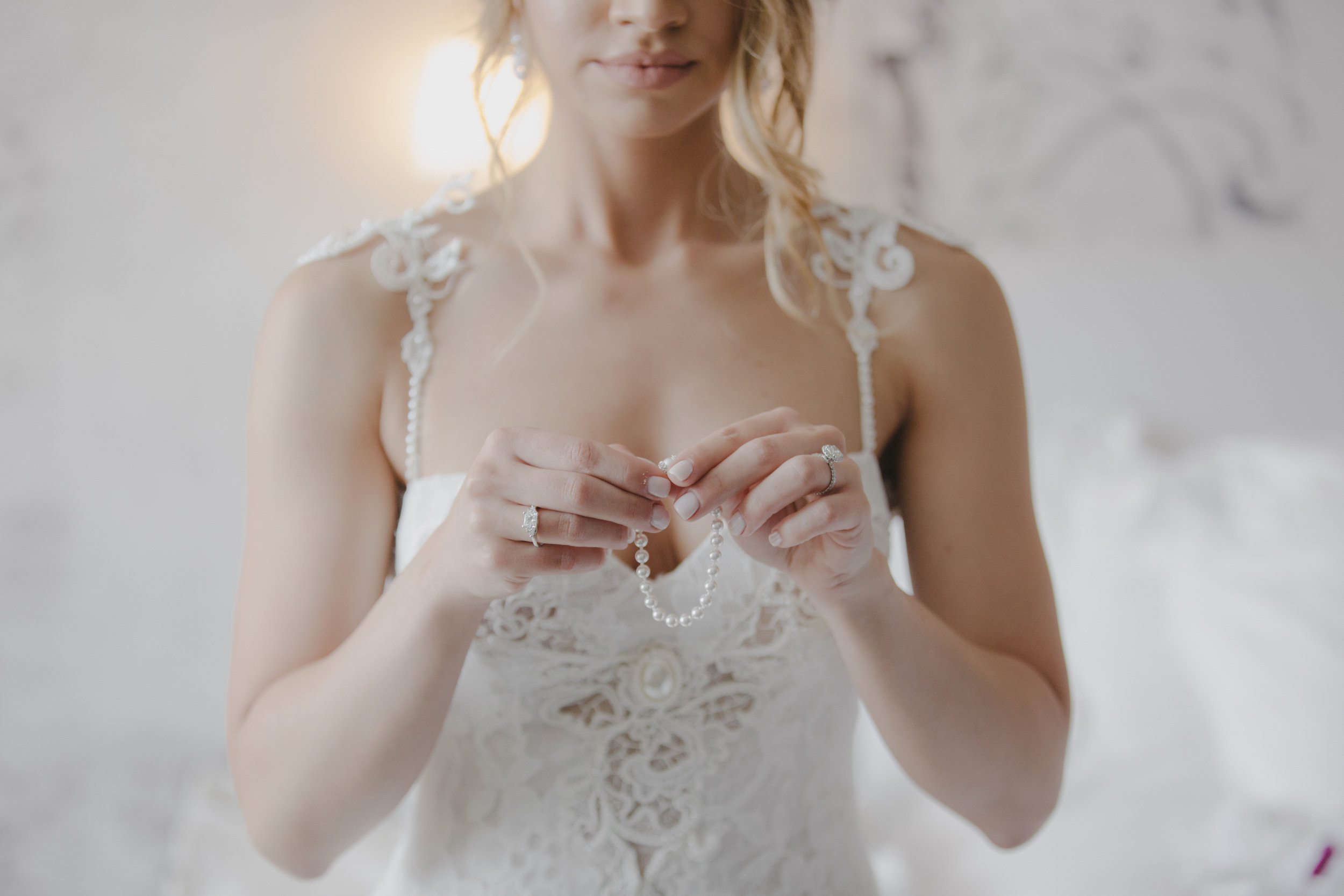 Pearl Wedding Jewelry ||  Luxury Destination Wedding Planning and Event Design by  Andrea Eppolito Events  · Photos by  Stephen Salazar  · Bride getting dressed.