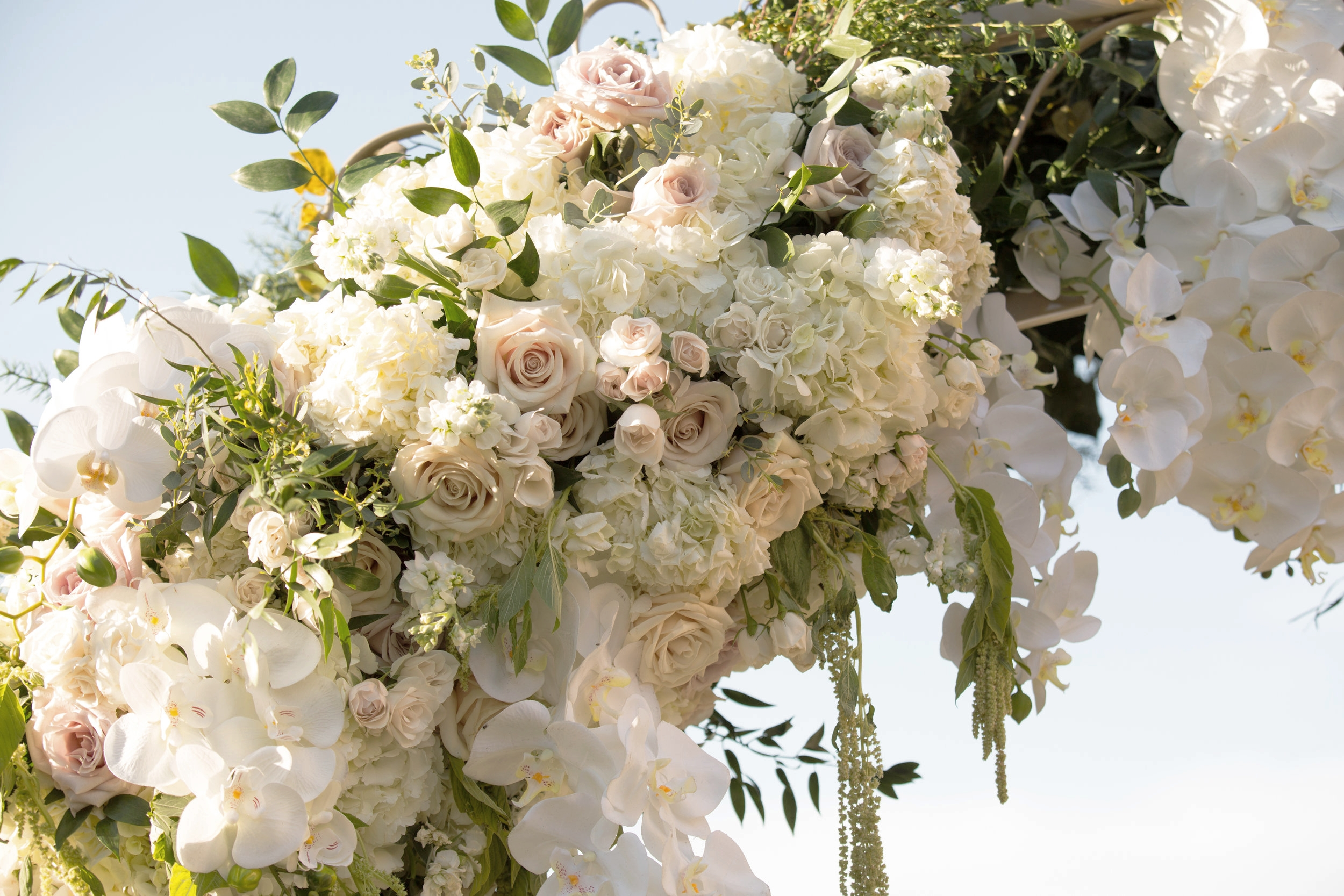 Lush hanging ceremony florals.  Luxury Destination Wedding Planning and Event Design by  Andrea Eppolito Events  · Photos by  Stephen Salazar