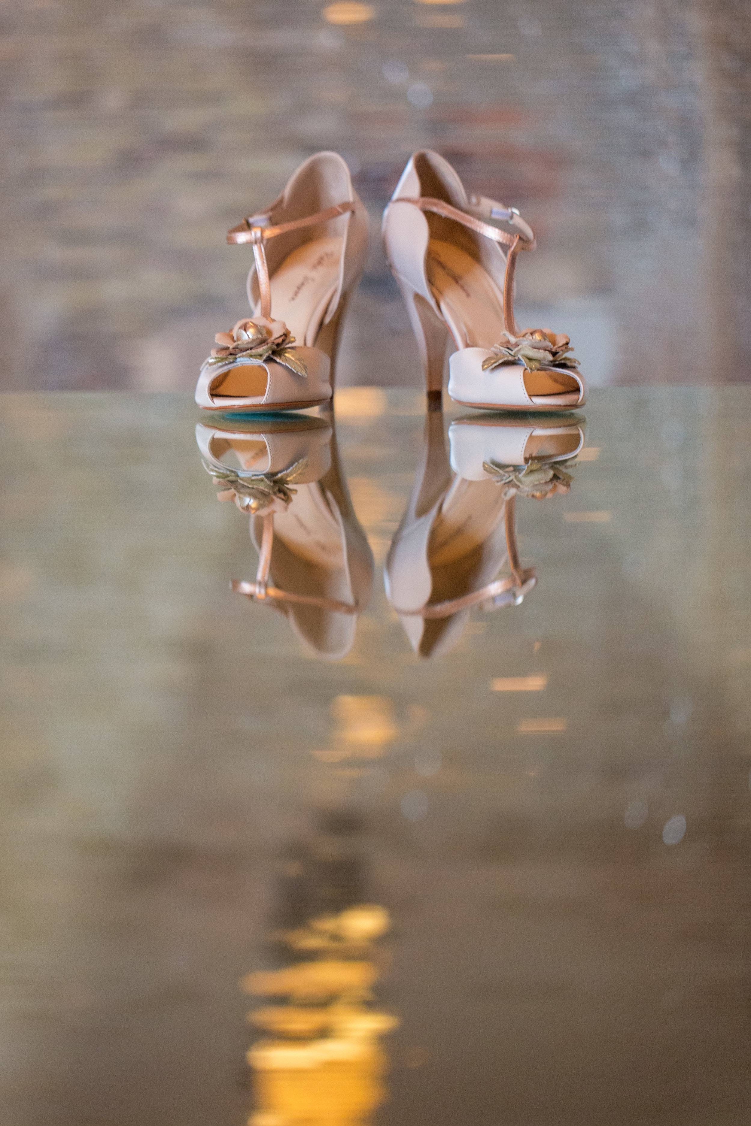 Pretty pink rosette wedding shoes.Wedding Planning by  Andrea Eppolito Events  · Photography by  Shandro Photo   · Wedding Venue  Four Seasons Las Vegas  · Floral and Decor by  Destination by Design  · Chandeliers and Lighting by  LED Unplugged