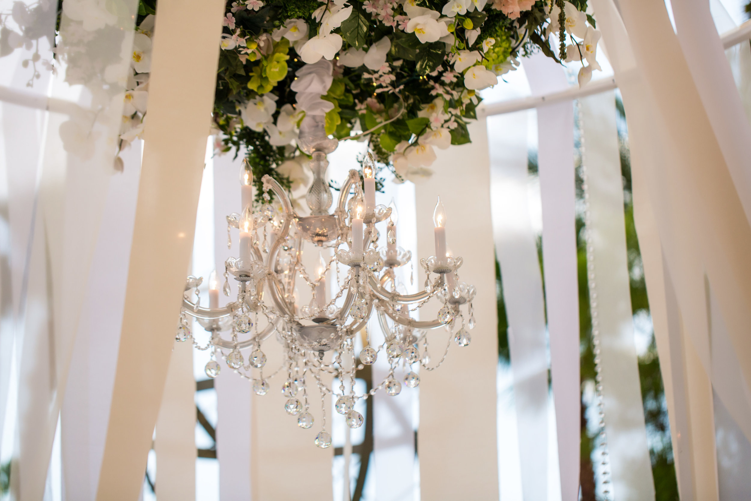 Floral chandelier.Wedding Planning by  Andrea Eppolito Events  · Photography by  Shandro Photo   · Wedding Venue  Four Seasons Las Vegas  · Floral and Decor by  Destination by Design  · Chandeliers and Lighting by  LED Unplugged