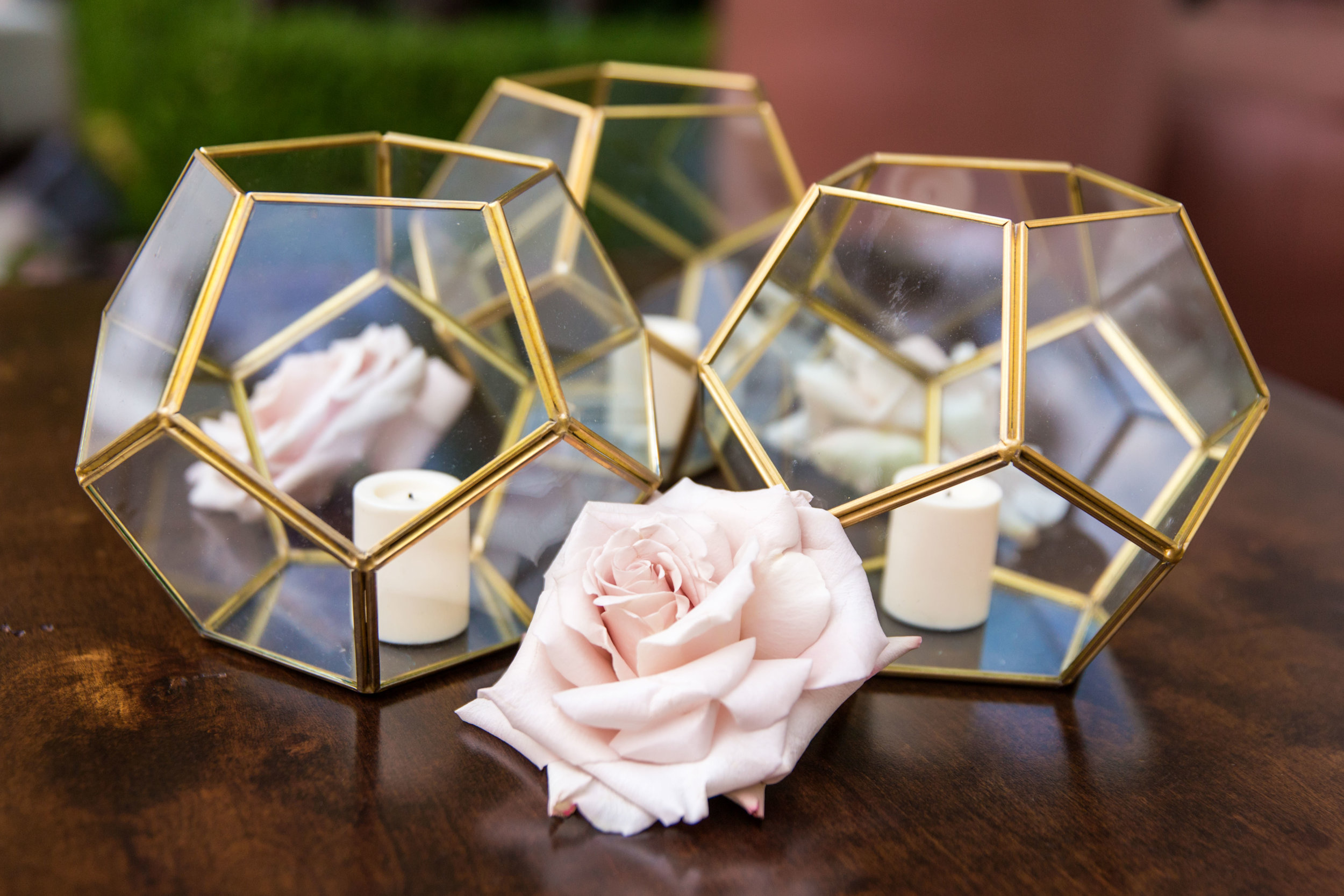 Gold and glass orbs with roses.Wedding Planning by  Andrea Eppolito Events  · Photography by  Shandro Photo   · Wedding Venue  Four Seasons Las Vegas  · Floral and Decor by  Destination by Design  · Chandeliers and Lighting by  LED Unplugged