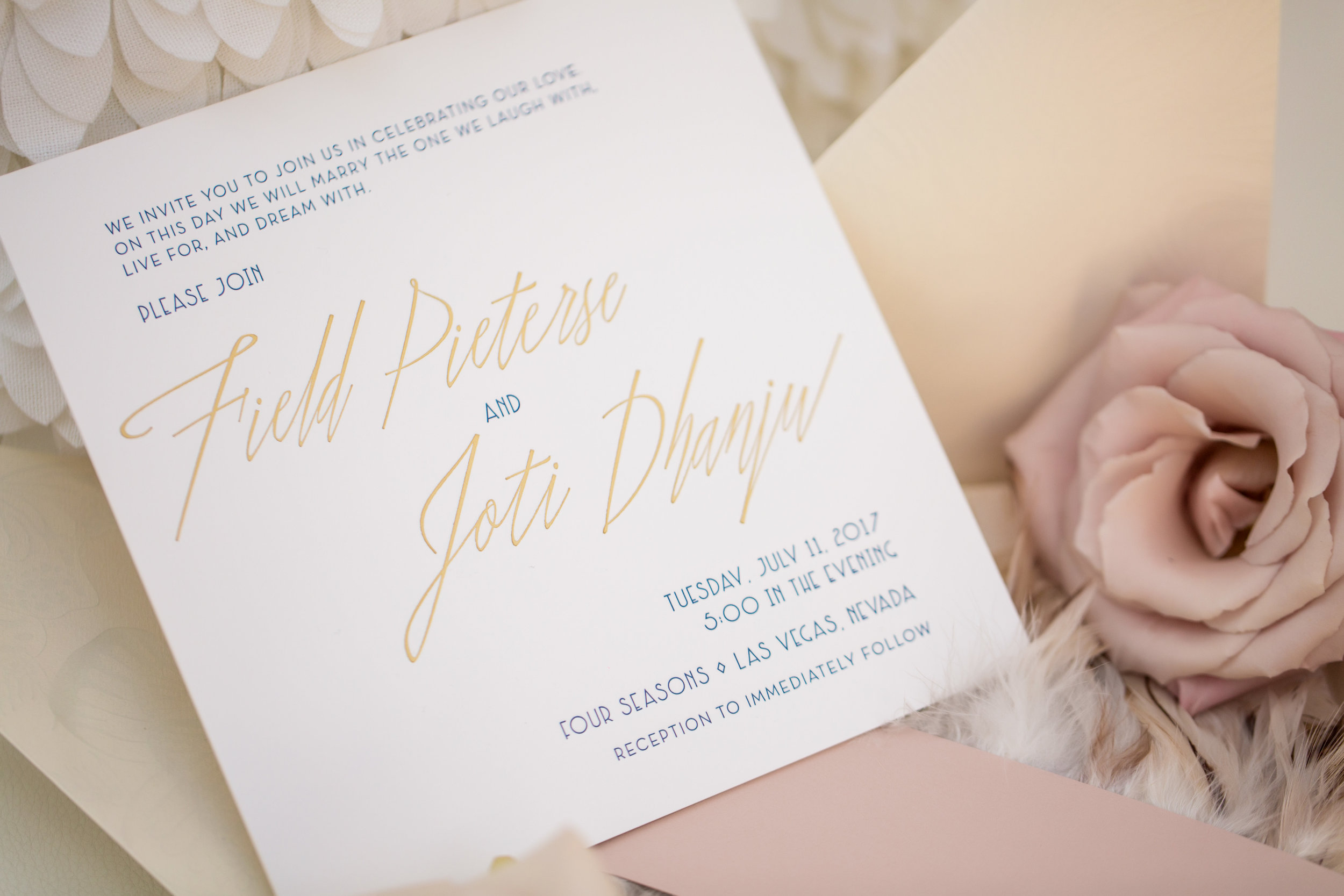 Invitations by CecI New York. Wedding Planning by  Andrea Eppolito Events  · Photography by  Shandro Photo   · Wedding Venue  Four Seasons Las Vegas  · Floral and Decor by  Destination by Design  · Chandeliers and Lighting by  LED Unplugged