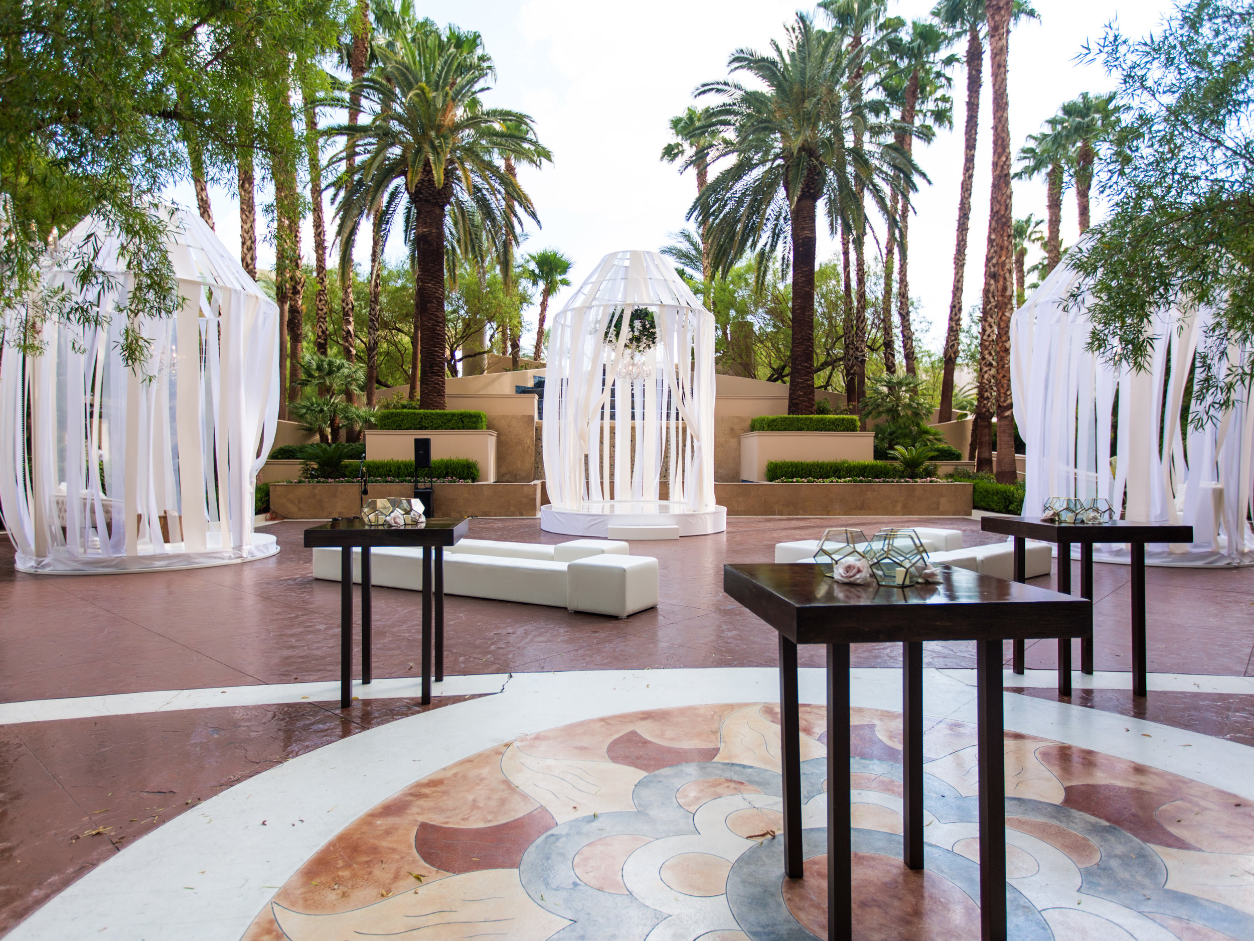 Wedding ceremony at the four seasons. Wedding Planning by  Andrea Eppolito Events  · Photography by  Shandro Photo   · Wedding Venue  Four Seasons Las Vegas  · Floral and Decor by  Destination by Design  · Cake by  Four Seasons Las Vegas  · Chandeliers and Lighting by  LED Unplugged  · Dress by  Berta