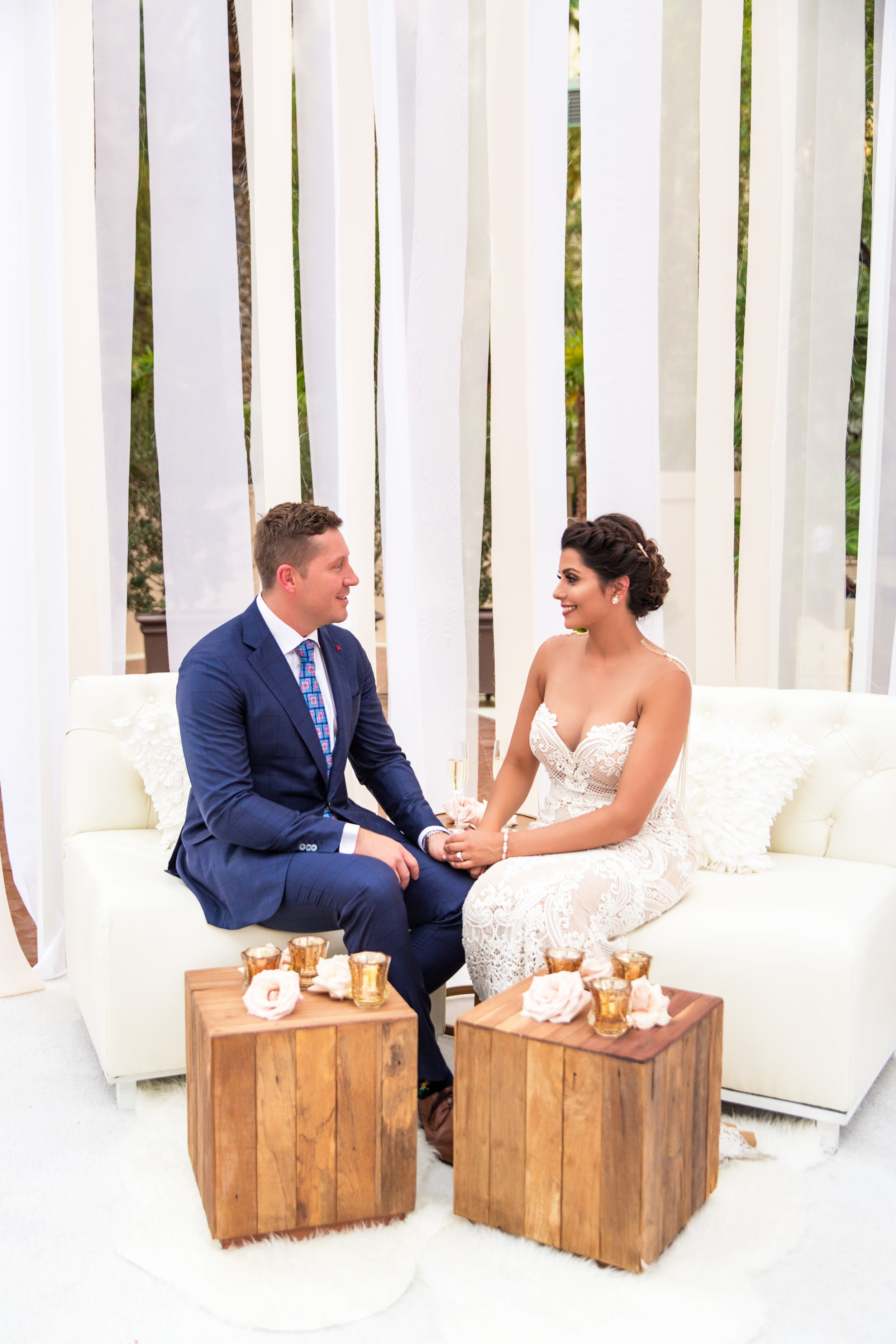 Couple e in their birdcage.Wedding Planning by  Andrea Eppolito Events  · Photography by  Shandro Photo   · Wedding Venue  Four Seasons Las Vegas  · Floral and Decor by  Destination by Design  · Cake by  Four Seasons Las Vegas  · Chandeliers and Lighting by  LED Unplugged  · Dress by  Berta