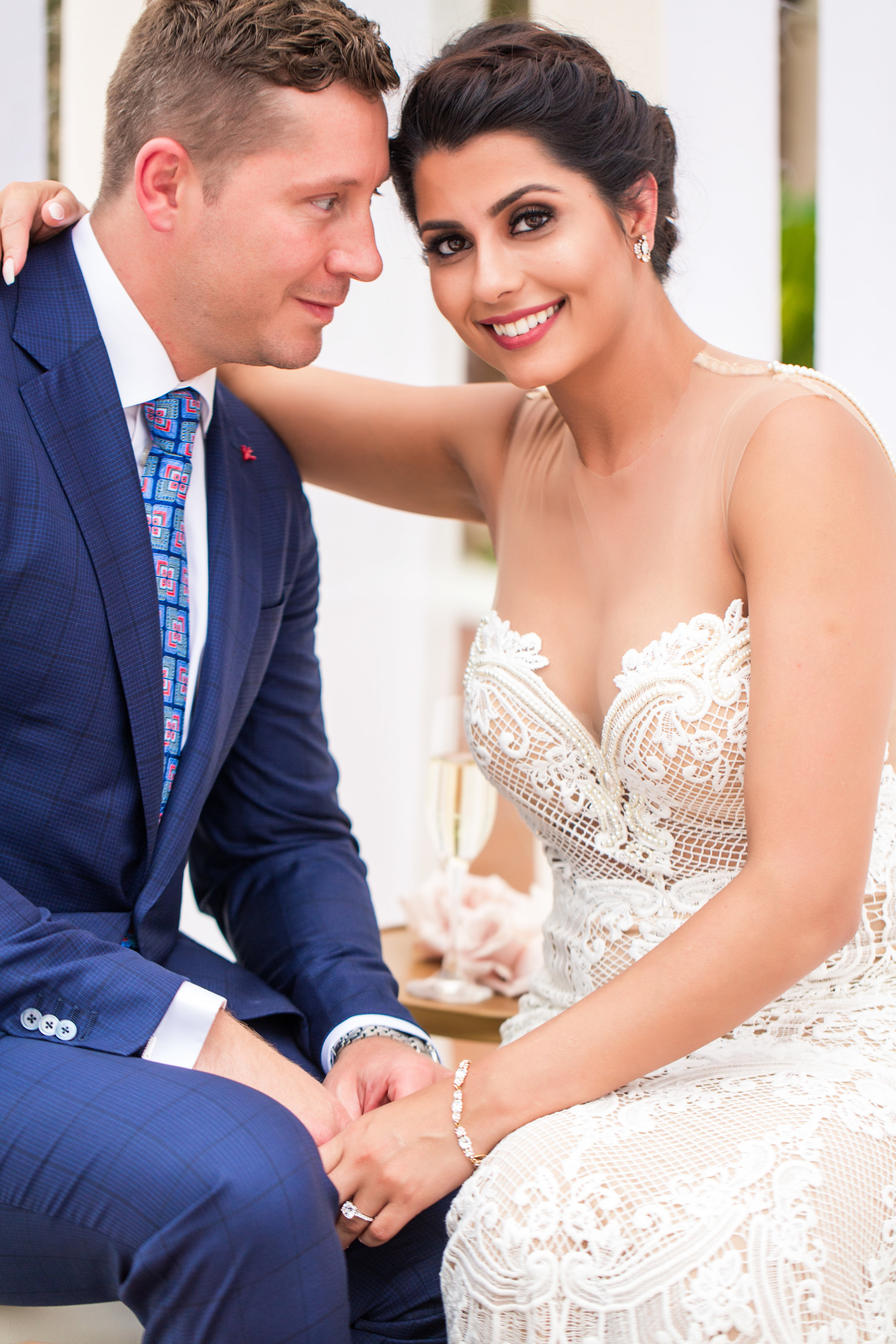 Groom in blue suit. Bride in Berta. Wedding Planning by  Andrea Eppolito Events  · Photography by  Shandro Photo   · Wedding Venue  Four Seasons Las Vegas  · Floral and Decor by  Destination by Design  · Cake by  Four Seasons Las Vegas  · Chandeliers and Lighting by  LED Unplugged  · Dress by  Berta