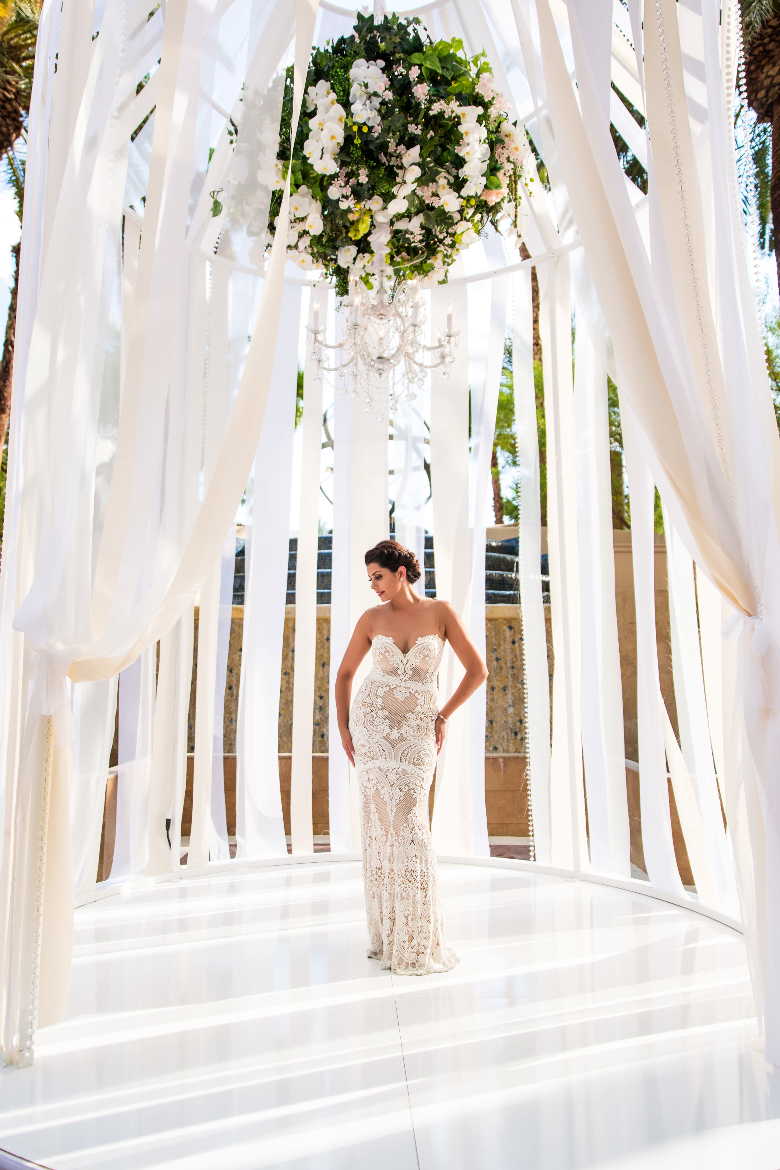 Bridal Portrait. Wedding Planning by  Andrea Eppolito Events  · Photography by  Shandro Photo   · Wedding Venue  Four Seasons Las Vegas  · Floral and Decor by  Destination by Design  · Cake by  Four Seasons Las Vegas  · Chandeliers and Lighting by  LED Unplugged  · Dress by  Berta
