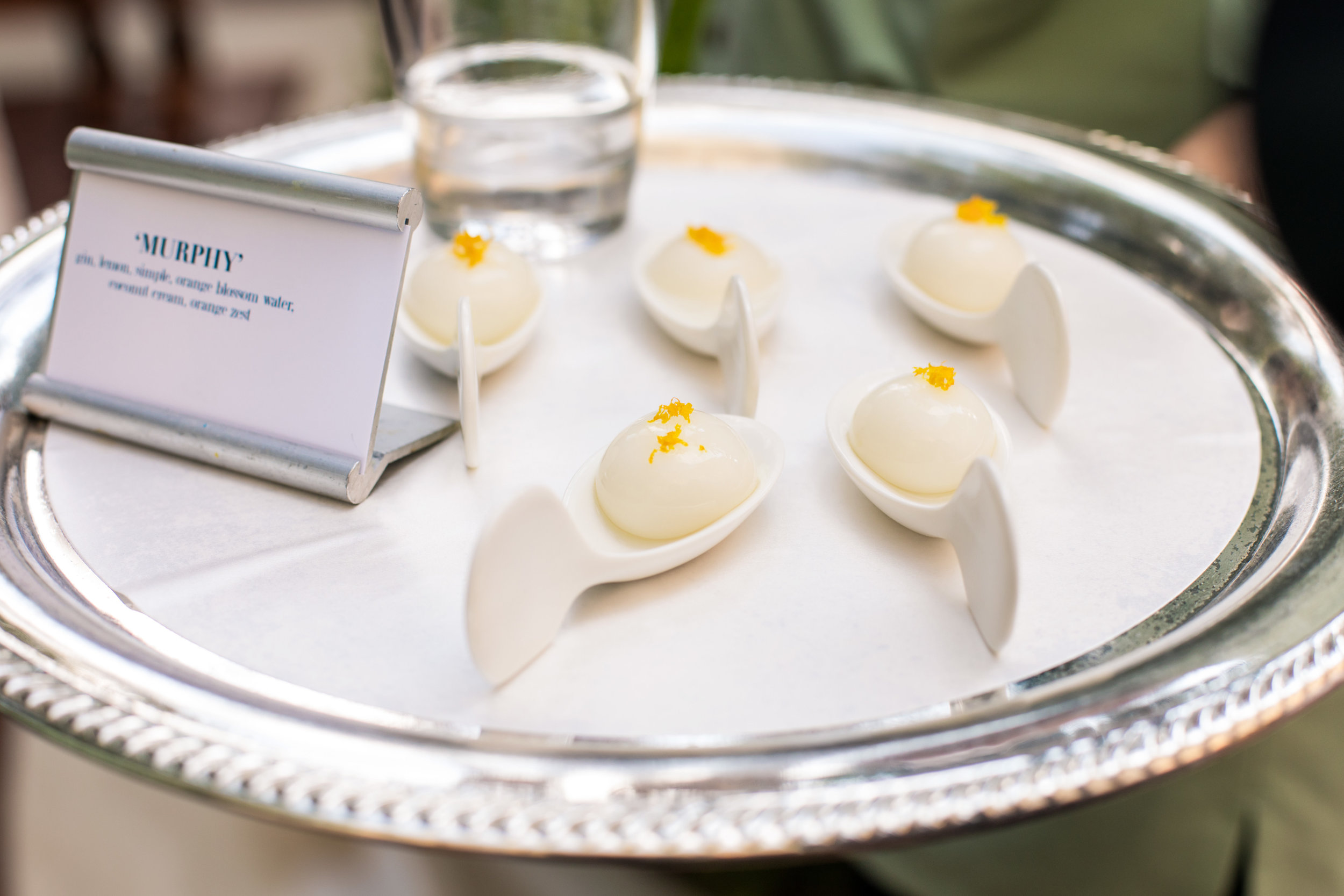 Edible Molecular Cocktails by The Grand Bevy.Wedding Planning by  Andrea Eppolito Events  · Photography by  Shandro Photo   · Wedding Venue  Four Seasons Las Vegas  · Floral and Decor by  Destination by Design  · Cake by  Four Seasons Las Vegas  · Chandeliers and Lighting by  LED Unplugged  · Dress by  Berta