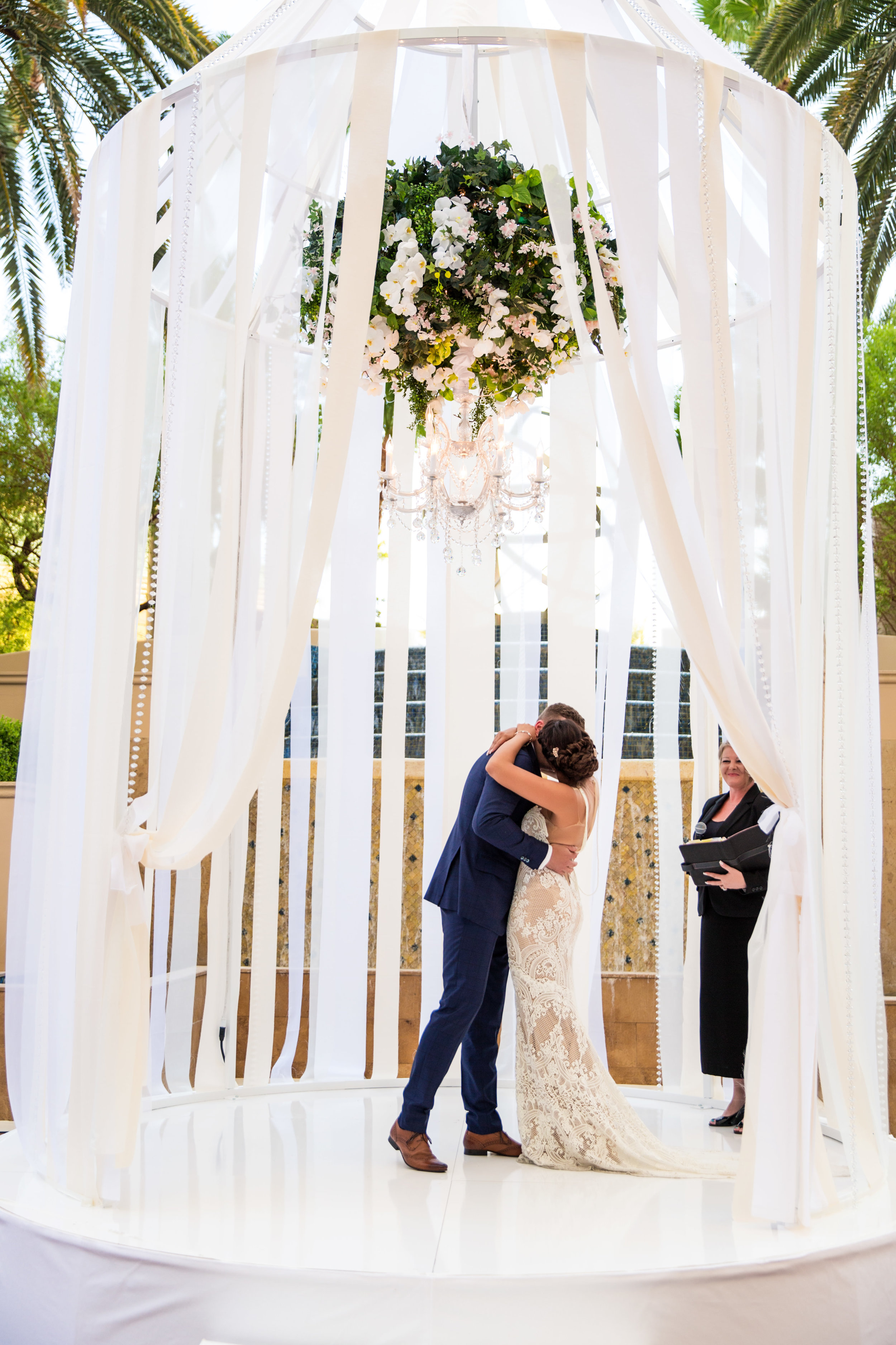 First kiss. Wedding Planning by  Andrea Eppolito Events  · Photography by  Shandro Photo   · Wedding Venue  Four Seasons Las Vegas  · Floral and Decor by  Destination by Design  · Cake by  Four Seasons Las Vegas  · Chandeliers and Lighting by  LED Unplugged  · Dress by  Berta
