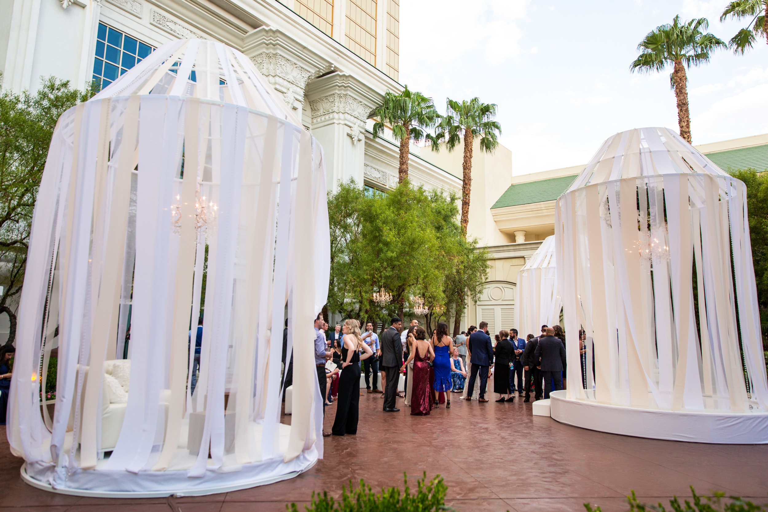 Wedding Cocktail Party.Wedding Planning by  Andrea Eppolito Events  · Photography by  Shandro Photo   · Wedding Venue  Four Seasons Las Vegas  · Floral and Decor by  Destination by Design  · Cake by  Four Seasons Las Vegas  · Chandeliers and Lighting by  LED Unplugged  · Dress by  Berta