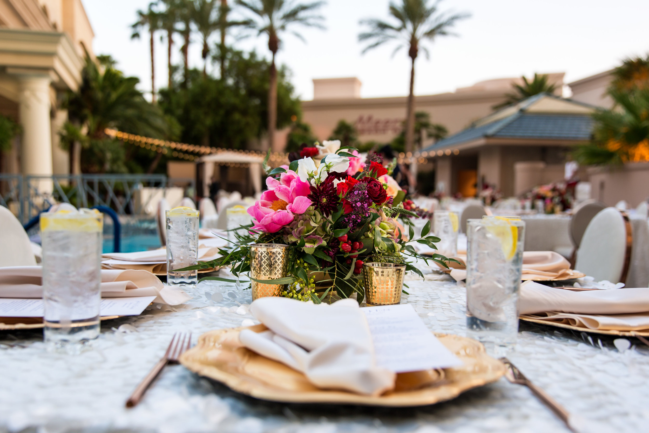 Jewel toned wedding centerpieces with gold accents.Wedding Planning by  Andrea Eppolito Events  · Photography by  Shandro Photo   · Wedding Venue  Four Seasons Las Vegas  · Floral and Decor by  Destination by Design  · Cake by  Four Seasons Las Vegas  · Chandeliers and Lighting by  LED Unplugged  · Dress by  Berta
