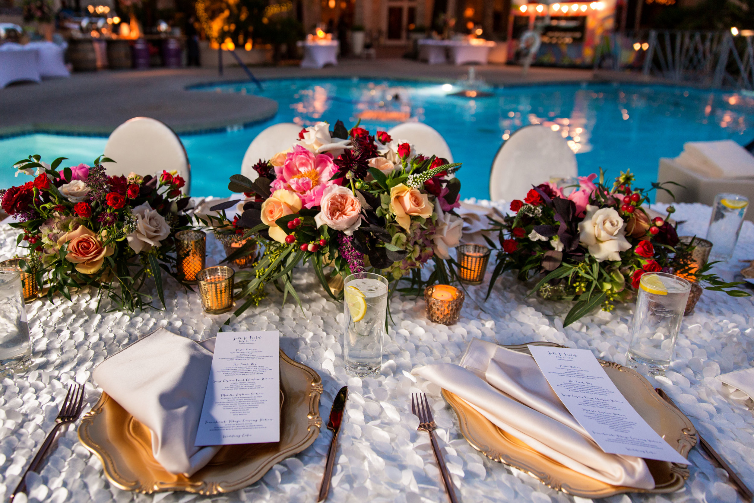 Jewel toned wedding centerpieces with gold accents.Wedding Planning by  Andrea Eppolito Events  · Photography by  Shandro Photo   · Wedding Venue  Four Seasons Las Vegas  · Floral and Decor by  Destination by Design  · Cake by  Four Seasons Las Vegas  · Chandeliers and Lighting by  LED Unplugged  · Dress by  Berta  and Menu by Alligator Soup