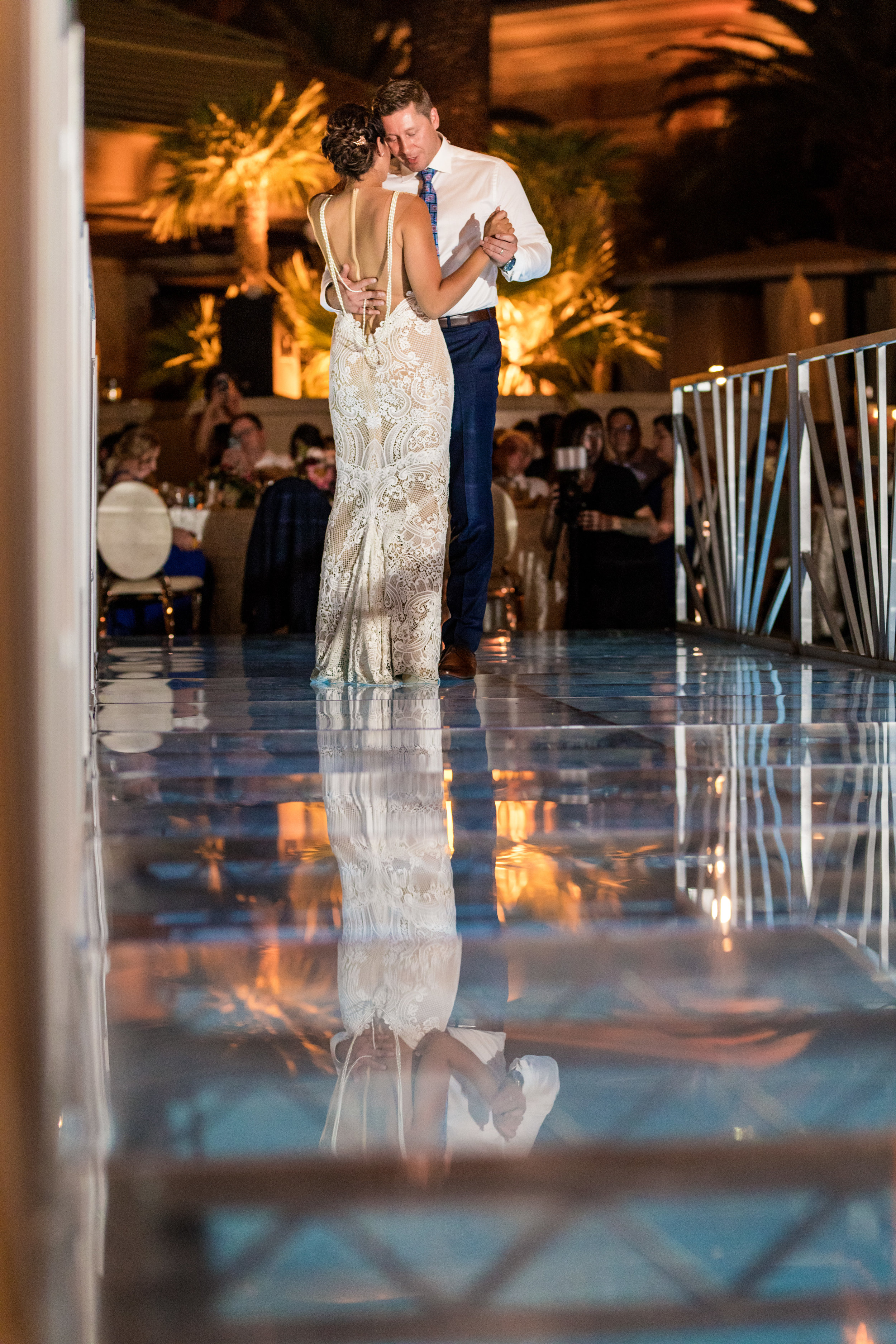 First Dance. First dance on bridge over pool.Jewel toned wedding centerpieces with gold accents.Wedding Planning by  Andrea Eppolito Events  · Photography by  Shandro Photo   · Wedding Venue  Four Seasons Las Vegas  · Floral and Decor by  Destination by Design  · Cake by  Four Seasons Las Vegas  · Chandeliers and Lighting by  LED Unplugged  · Dress by  Berta  and Menu by Alligator Soup