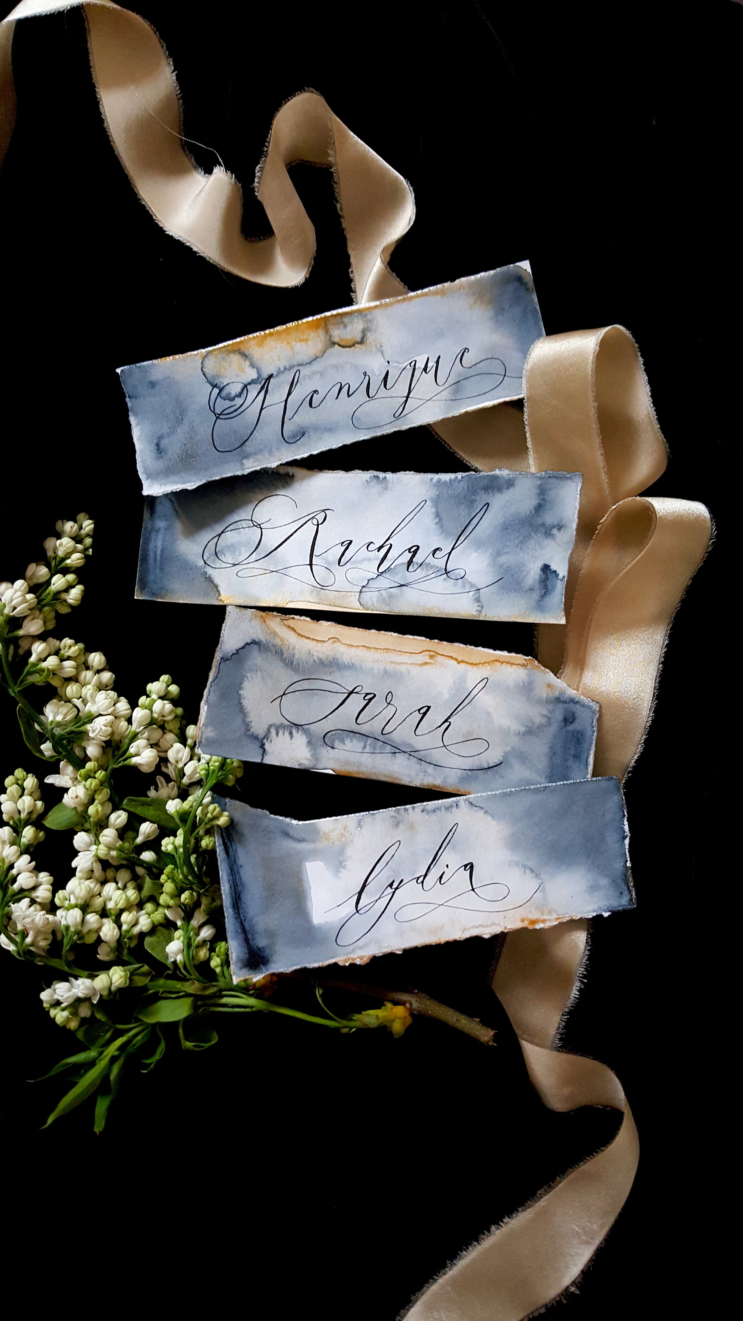 Hand painted place cards in black and gold. Photo by Crimson Letters.