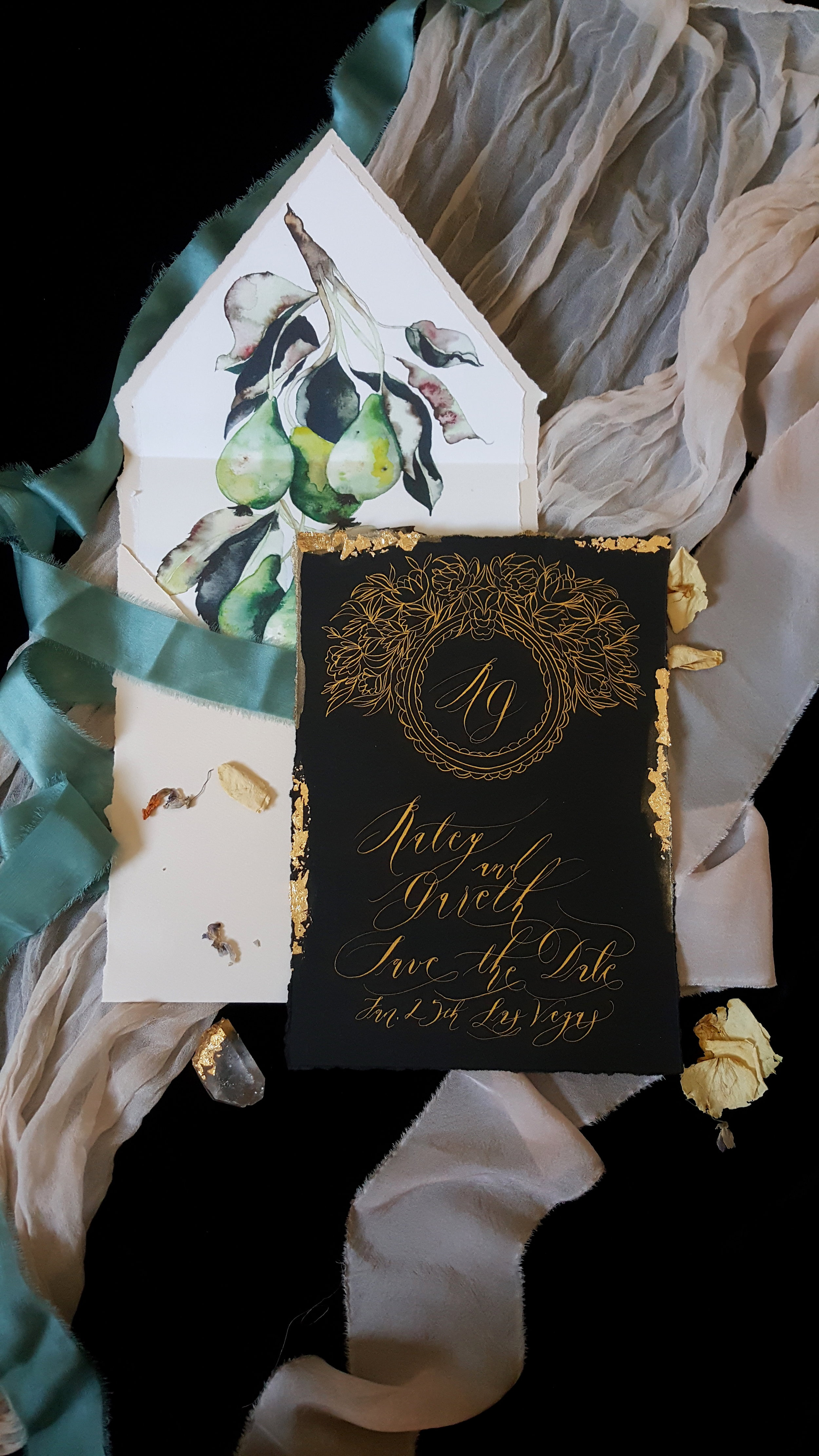 hand painted stationery suite in black, gold, and teal.