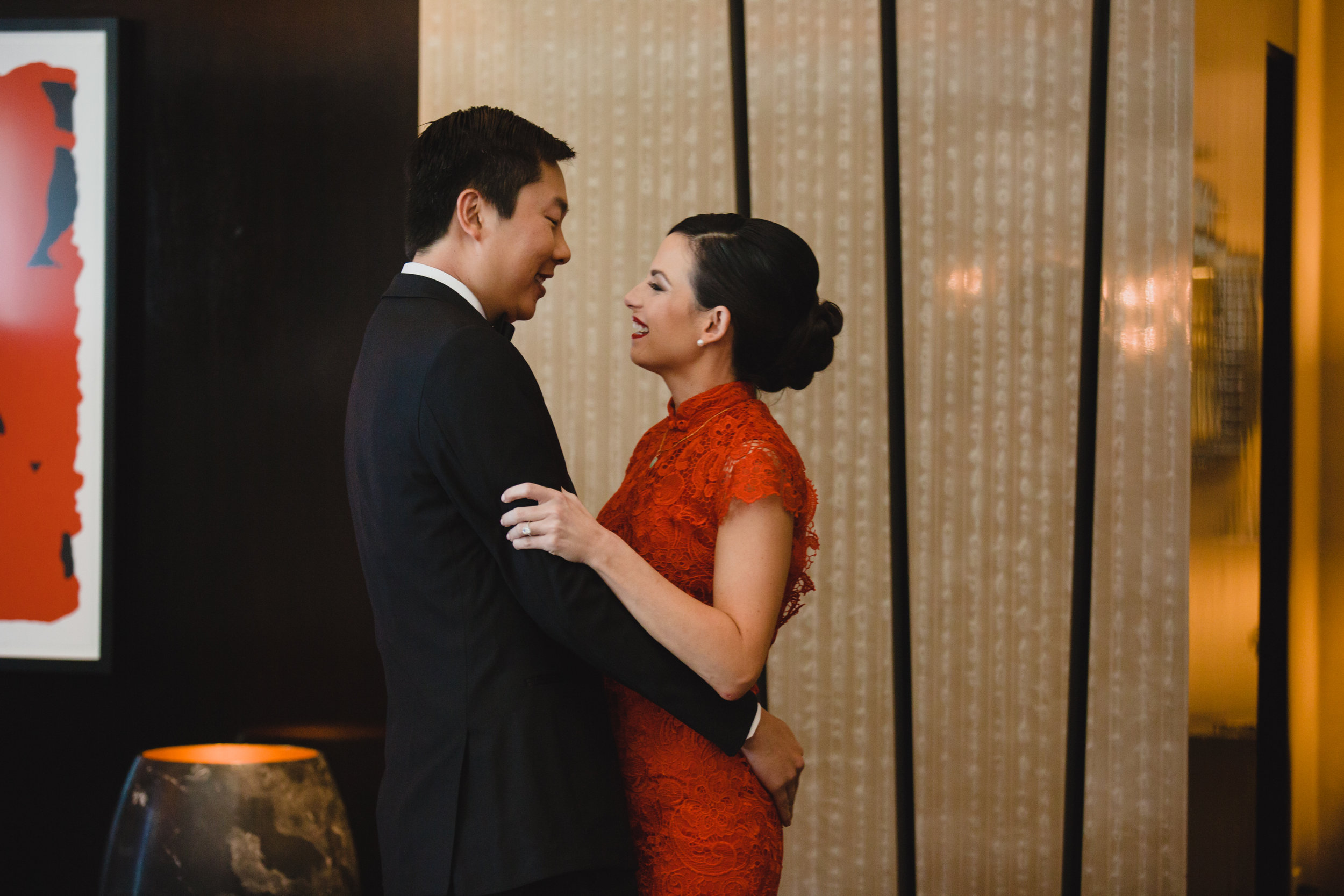 Chinese Tea Ceremony.Luxury wedding at the Mandarin Oriental with a color scheme of white, blush, and pops of wine red produced by Las Vegas Wedding Planner Andrea Eppolito with photos by Stephen Salazar Photography.