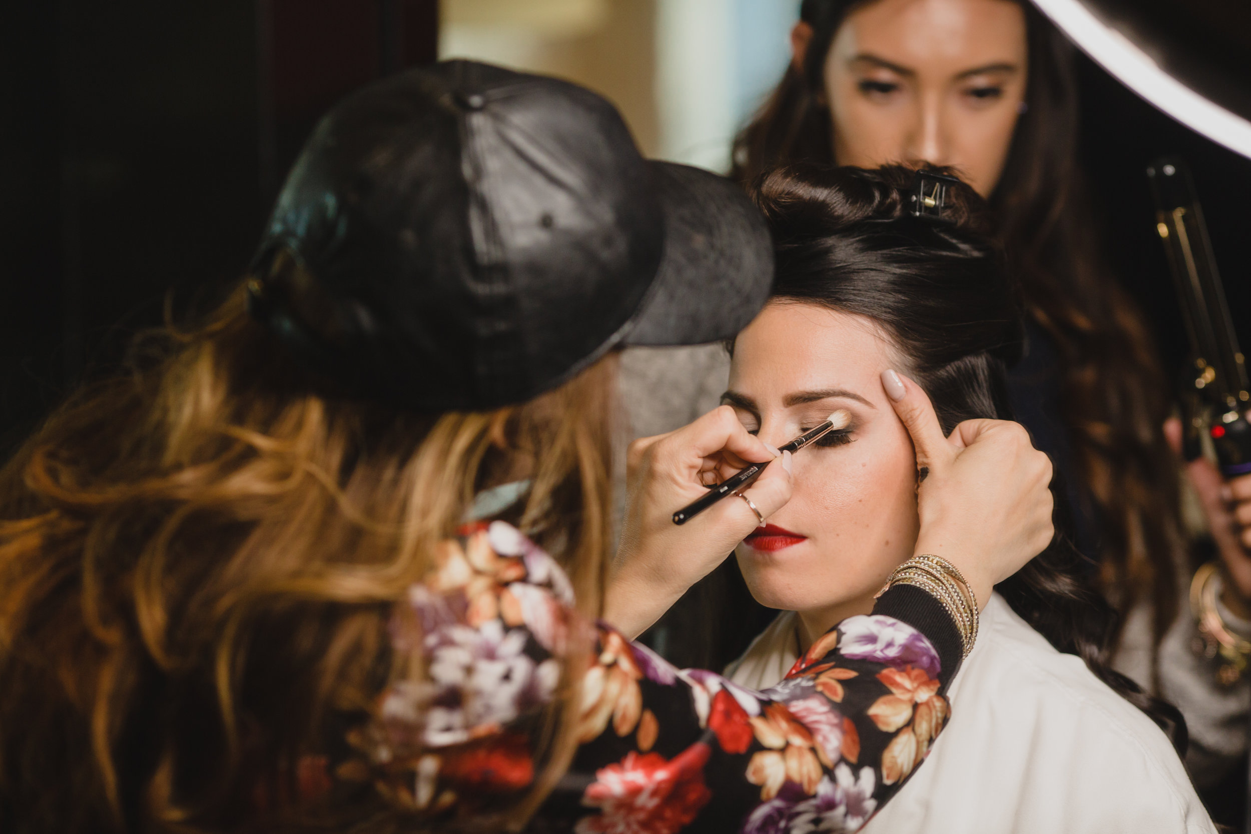 Hair and make up in Las Vegas. Luxury wedding at the Mandarin Oriental with a color scheme of white, blush, and pops of wine red produced by Las Vegas Wedding Planner Andrea Eppolito with photos by Stephen Salazar Photography.
