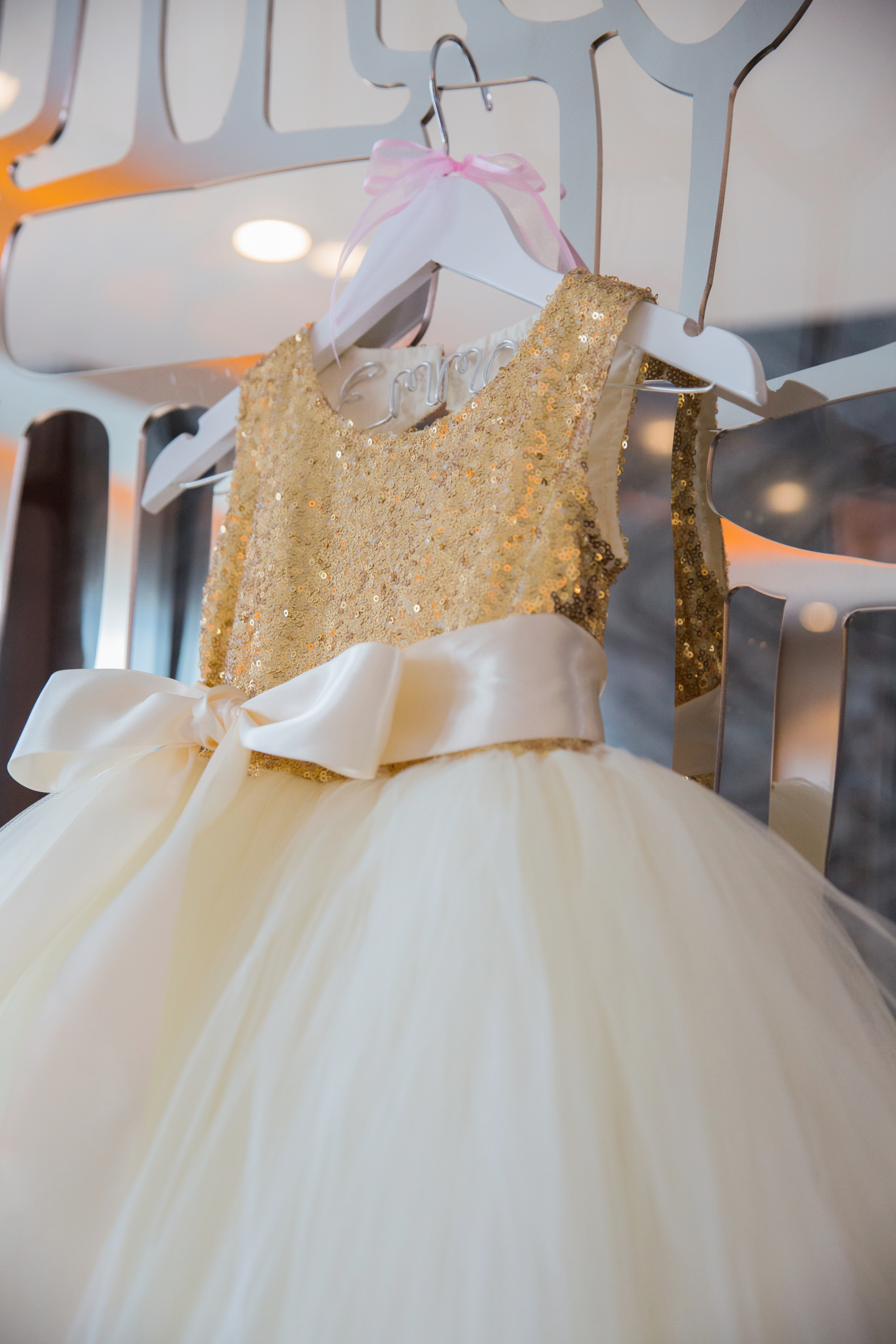 Bridesmaid Dress in Ivory and Gold.Luxury wedding at the Mandarin Oriental with a color scheme of white, blush, and pops of wine red produced by Las Vegas Wedding Planner Andrea Eppolito with photos by Stephen Salazar Photography.