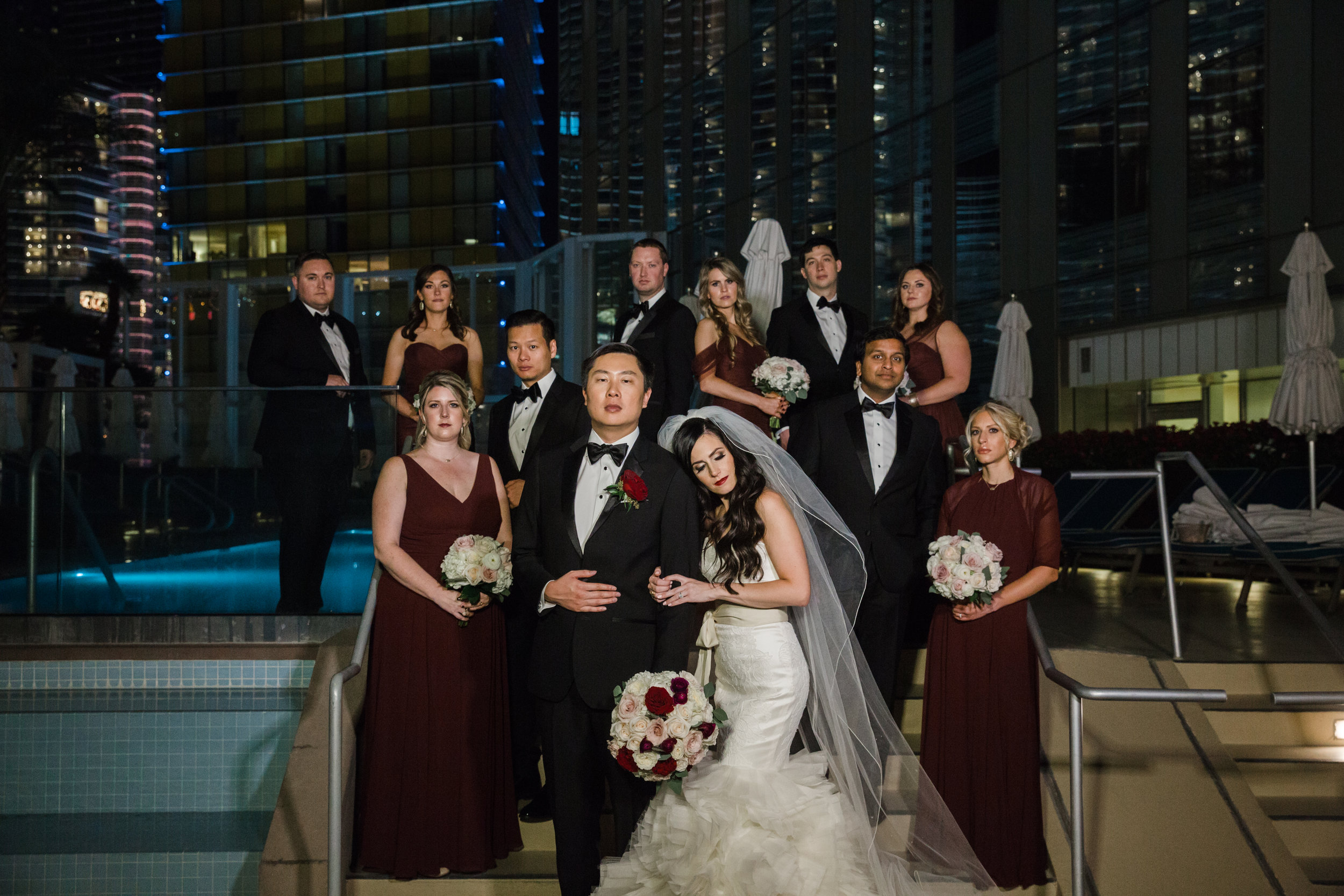 Bridal party portraits on rooftop.Luxury wedding at the Mandarin Oriental with a color scheme of white, blush, and pops of wine red produced by Las Vegas Wedding Planner Andrea Eppolito with photos by Stephen Salazar Photography.