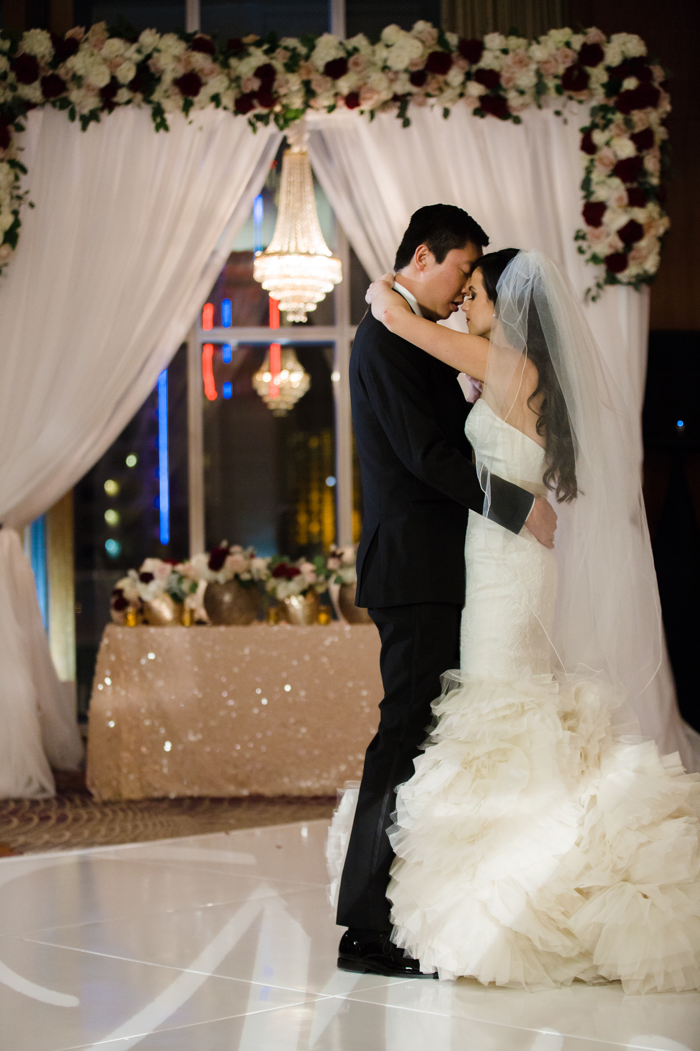 Bride and groom first dance all alone.Luxury wedding at the Mandarin Oriental with a color scheme of white, blush, and pops of wine red produced by Las Vegas Wedding Planner Andrea Eppolito with photos by Stephen Salazar Photography.