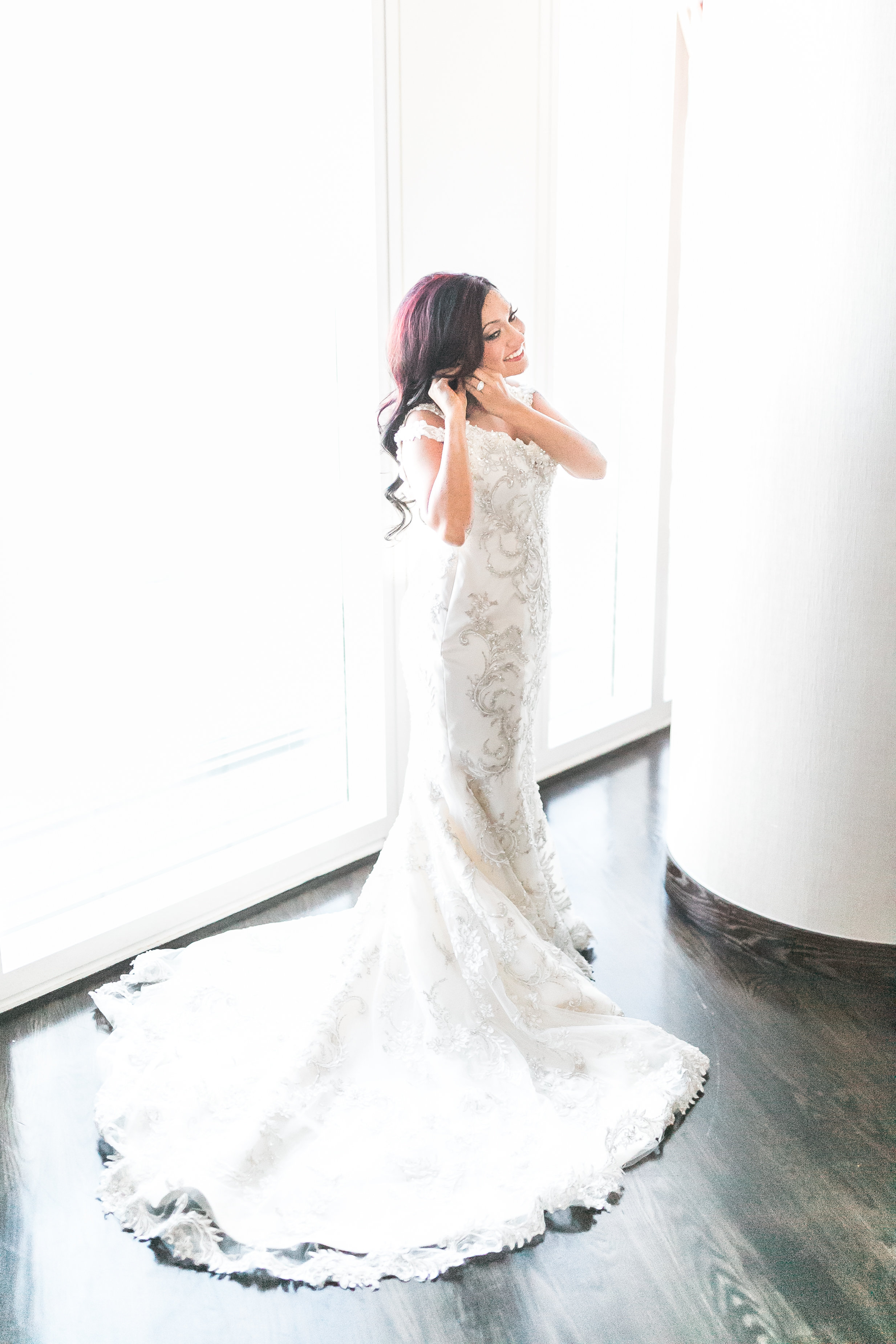 The bride wore a lace, off the shoulder wedding gown from Maggie Sottero.  Las Vegas Wedding Planner Andrea Eppolito shares this multicultural wedding.  Photo by J.Anne Photography.