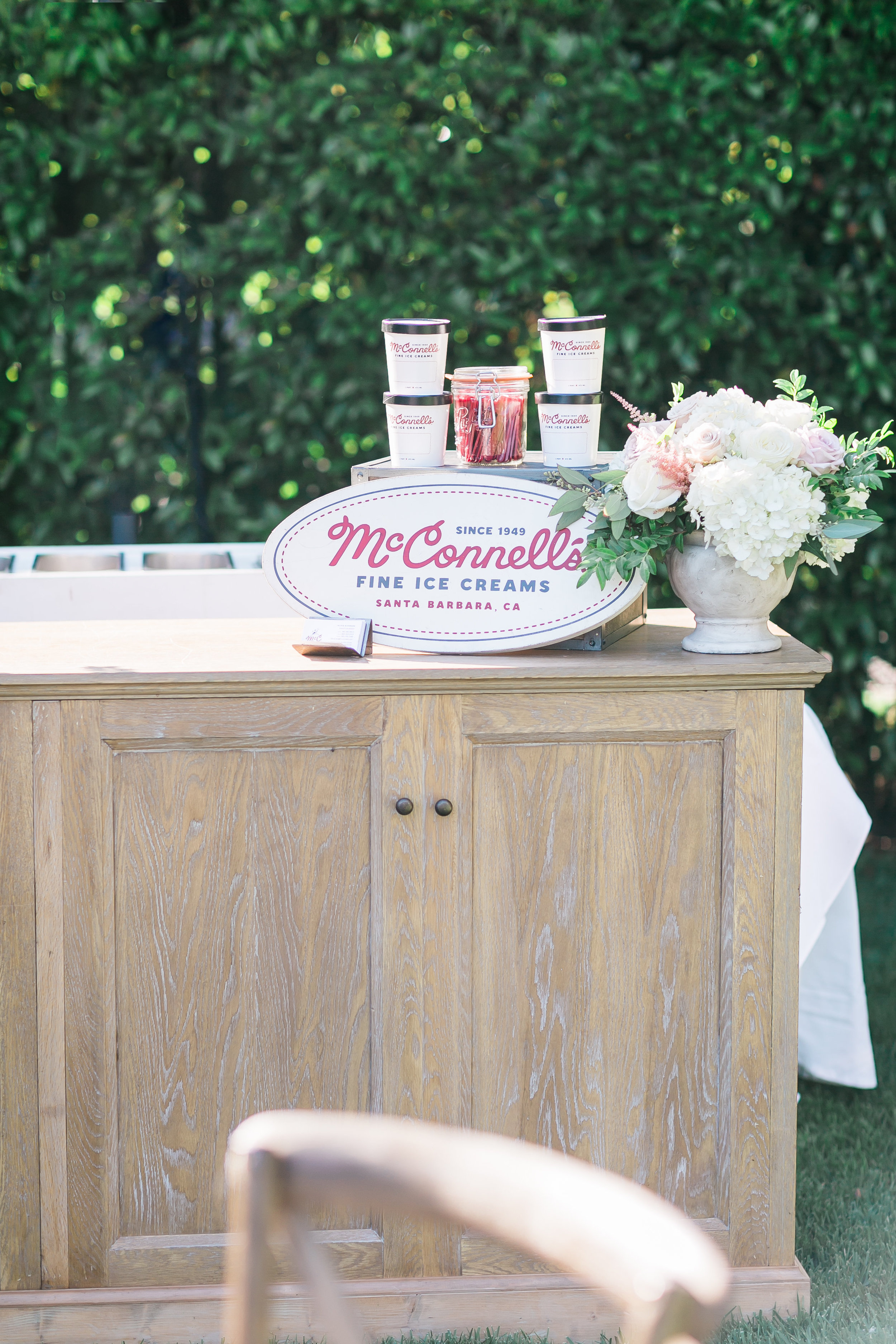 McConnell's Ice Cream Bar.    Destination Wedding Planner  ANDREA EPPOLITO EVENTS  · Images by  J.ANNE P  HOTOOGRAPHY  · Video  HOO FILMS  · Venue Ritz Carlton Bacara Santa Barbara ·Gown MONIQUE LHULLIER ·Bridesmaids Dresses  SHOW ME YOUR MUMU ·Stationery  SHE PAPERIE ·Bride's Shoes  BADGLEY MISCHKA ·Hair and Makeup  TEAM HAIR AND MAKEUP · Floral  BLUE MAGNOLIA ·Linen  LA TAVOLA ·Decor Rentals  TENT MERCHANT ·Calligraphy  EBB ·Lighting  FIVE STAR AV ·Ice Cream Station  MCCONNELL'S ICE CREAM