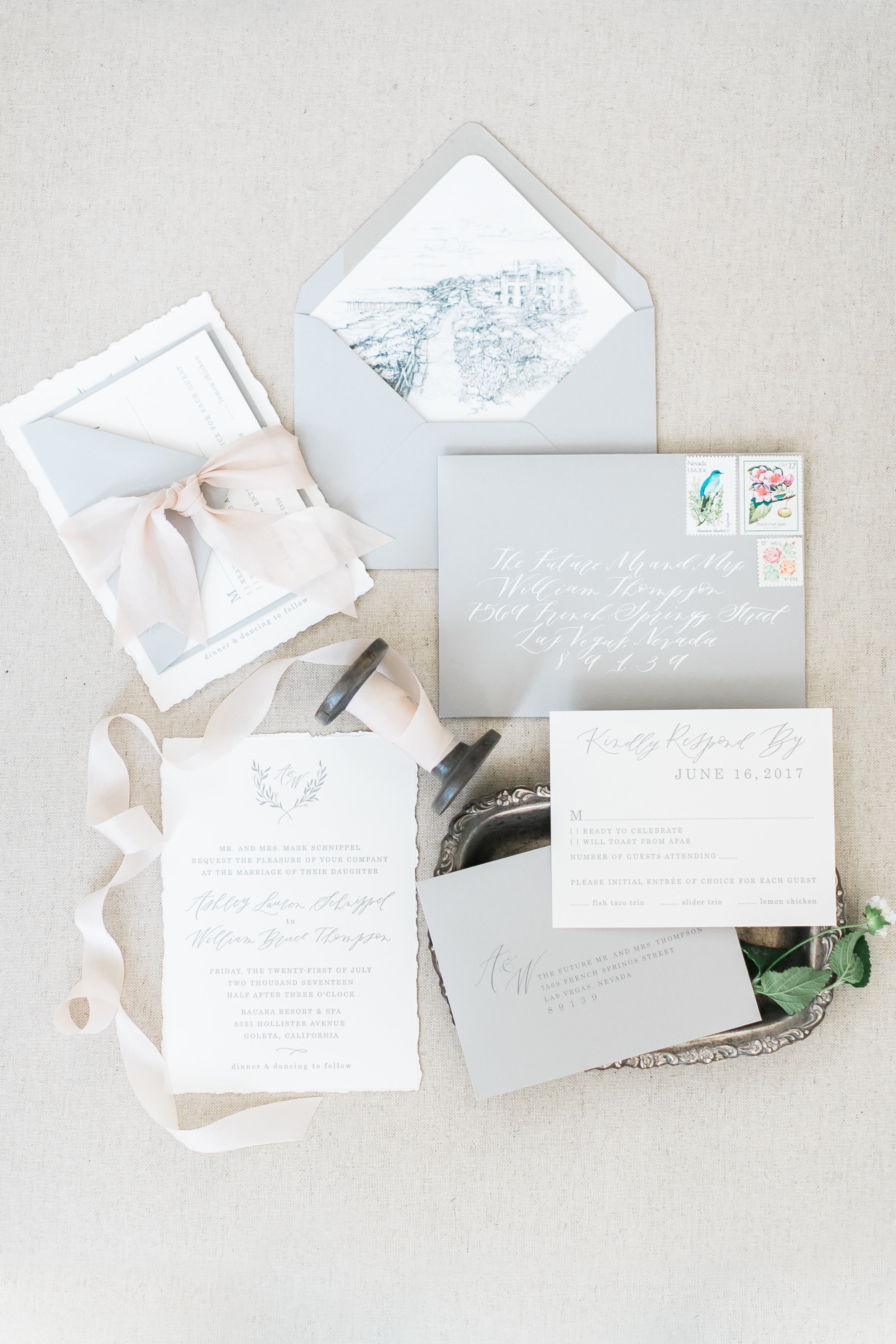 Grey and ivory invitations with custom liner.     Destination Wedding Planner  ANDREA EPPOLITO EVENTS  · Images by  J.ANNE P  HOTOOGRAPHY  · Video  HOO FILMS  · Venue Ritz Carlton Bacara Santa Barbara ·Gown MONIQUE LHULLIER ·Bridesmaids Dresses  SHOW ME YOUR MUMU ·Stationery  SHE PAPERIE ·Bride's Shoes  BADGLEY MISCHKA ·Hair and Makeup  TEAM HAIR AND MAKEUP · Floral  BLUE MAGNOLIA ·Linen  LA TAVOLA ·Decor Rentals  TENT MERCHANT ·Calligraphy  EBB ·Lighting  FIVE STAR AV ·Ice Cream Station  MCCONNELL'S ICE CREAM