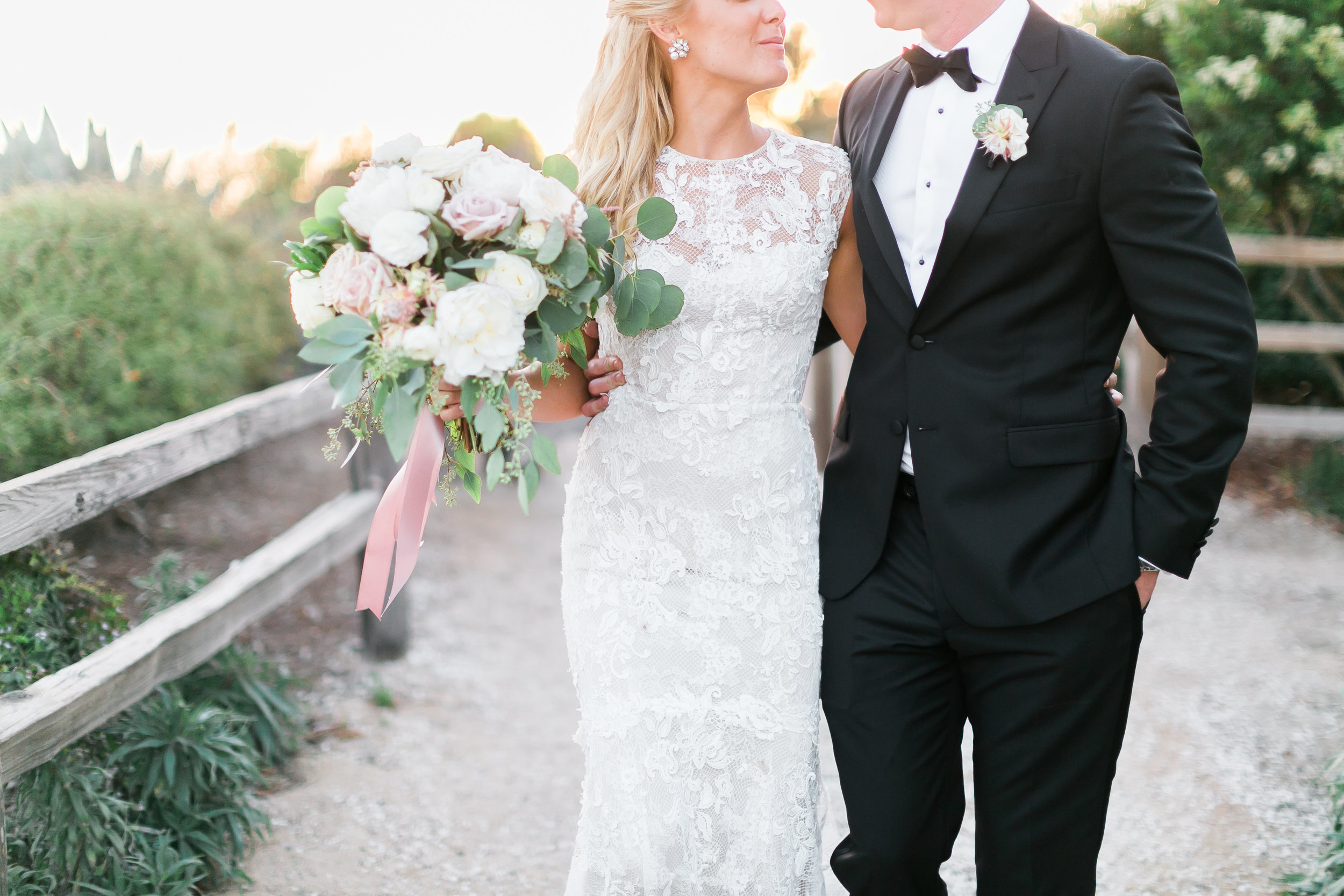 Classic timeless wedding at the Ritz Carlton Bacara Santa Barbara.   CREDITS:  Destination Wedding Planner  ANDREA EPPOLITO EVENTS  · Images by  J.ANNE P  HOTOGRAPHY  · Video  HOO FILMS  · Venue Ritz Carlton Bacara Santa Barbara ·Gown  MONIQUE LHULLIER ·Bridesmaids Dresses  SHOW ME YOUR MUMU ·Stationery  SHE PAPERIE ·Bride's Shoes  BADGLEY MISCHKA ·Hair and Makeup  TEAM HAIR AND MAKEUP · Floral  BLUE MAGNOLIA ·Linen  LA TAVOLA ·Decor Rentals  TENT MERCHANT ·Calligraphy  EBB ·Lighting  FIVE STAR AV ·Ice Cream Station  MCCONNELL'S ICE CREAM