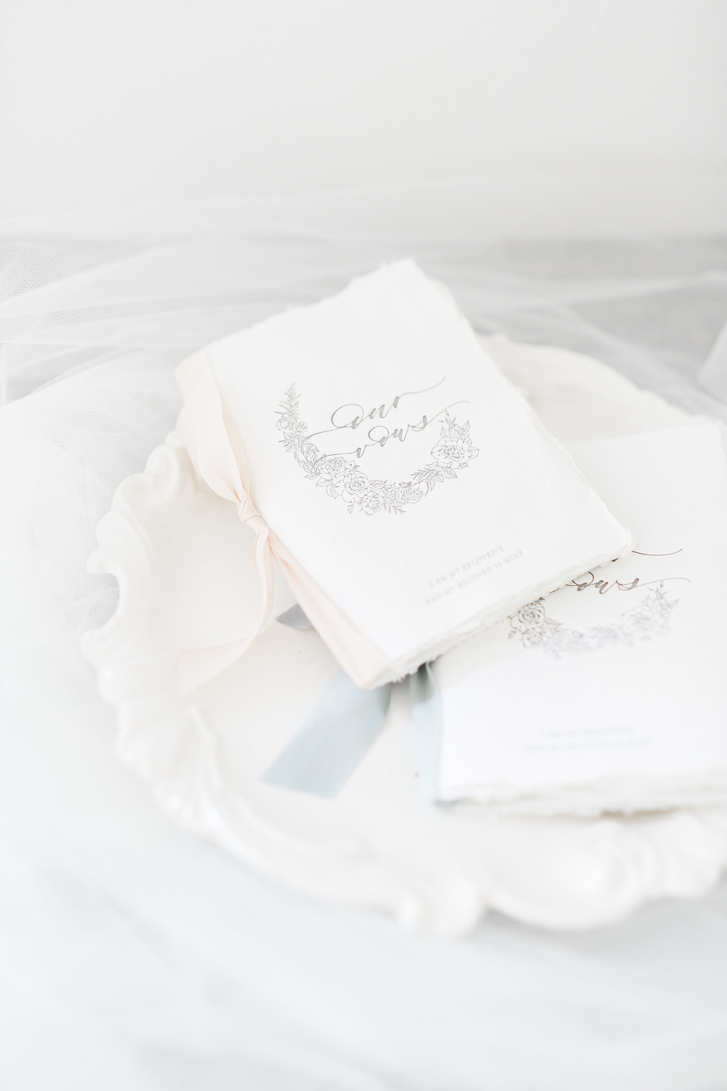 Custom Vow Books.   CREDITS:  Destination Wedding Planner  ANDREA EPPOLITO EVENTS  · Images by  J.ANNE P  HOTOGRAPHY  · Video  HOO FILMS  · Venue Ritz Carlton Bacara Santa Barbara ·Gown  MONIQUE LHULLIER ·Bridesmaids Dresses  SHOW ME YOUR MUMU ·Stationery  SHE PAPERIE ·Bride's Shoes  BADGLEY MISCHKA ·Hair and Makeup  TEAM HAIR AND MAKEUP · Floral  BLUE MAGNOLIA ·Linen  LA TAVOLA ·Decor Rentals  TENT MERCHANT ·Calligraphy  EBB ·Lighting  FIVE STAR AV ·Ice Cream Station  MCCONNELL'S ICE CREAM