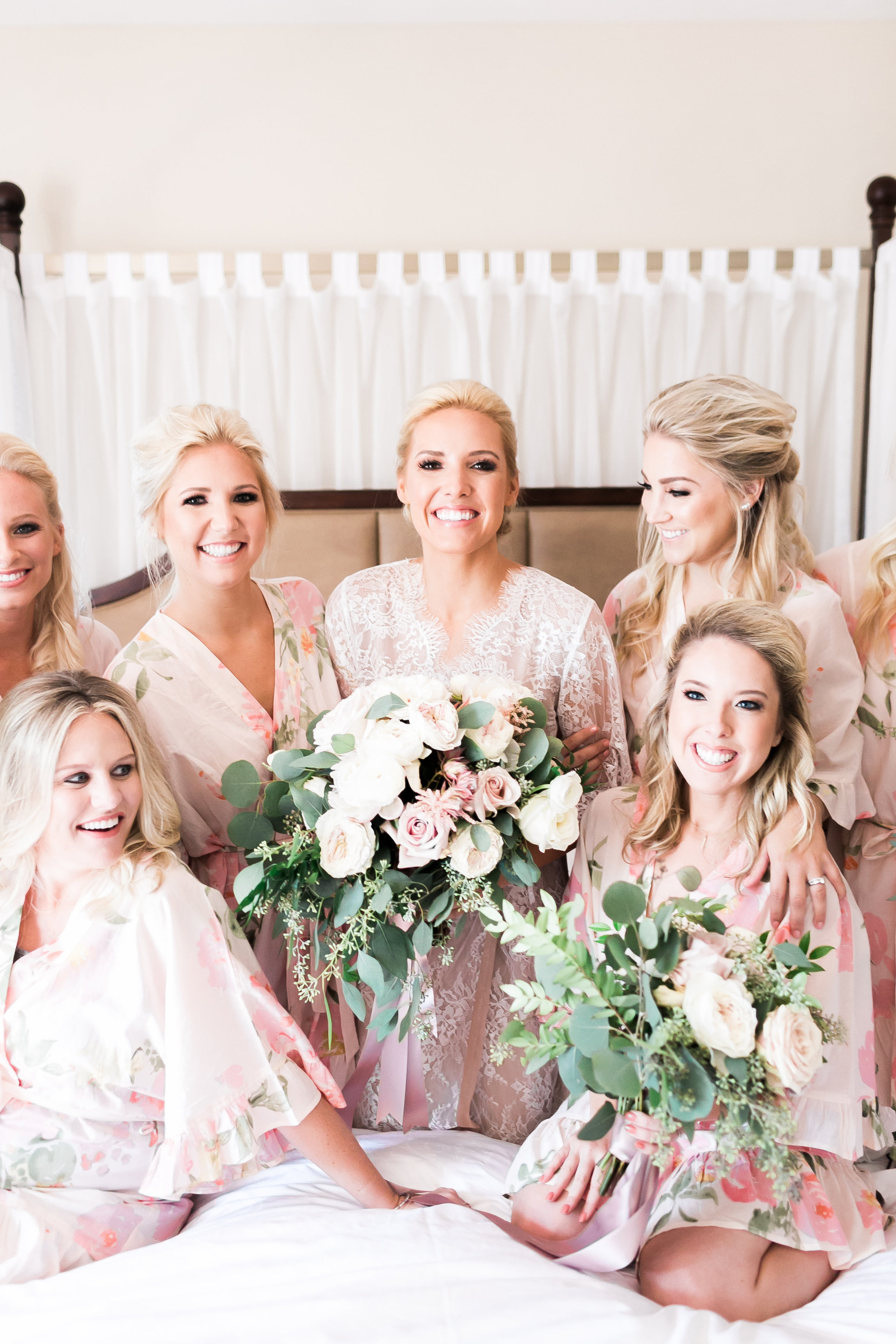 Bride and bridesmaids in prink robes.   CREDITS:  Destination Wedding Planner  ANDREA EPPOLITO EVENTS  · Images by  J.ANNE P  HOTOGRAPHY  · Video  HOO FILMS  · Venue Ritz Carlton Bacara Santa Barbara ·Gown  MONIQUE LHULLIER ·Bridesmaids Dresses  SHOW ME YOUR MUMU ·Stationery  SHE PAPERIE ·Bride's Shoes  BADGLEY MISCHKA ·Hair and Makeup  TEAM HAIR AND MAKEUP · Floral  BLUE MAGNOLIA ·Linen  LA TAVOLA ·Decor Rentals  TENT MERCHANT ·Calligraphy  EBB ·Lighting  FIVE STAR AV ·Ice Cream Station  MCCONNELL'S ICE CREAM
