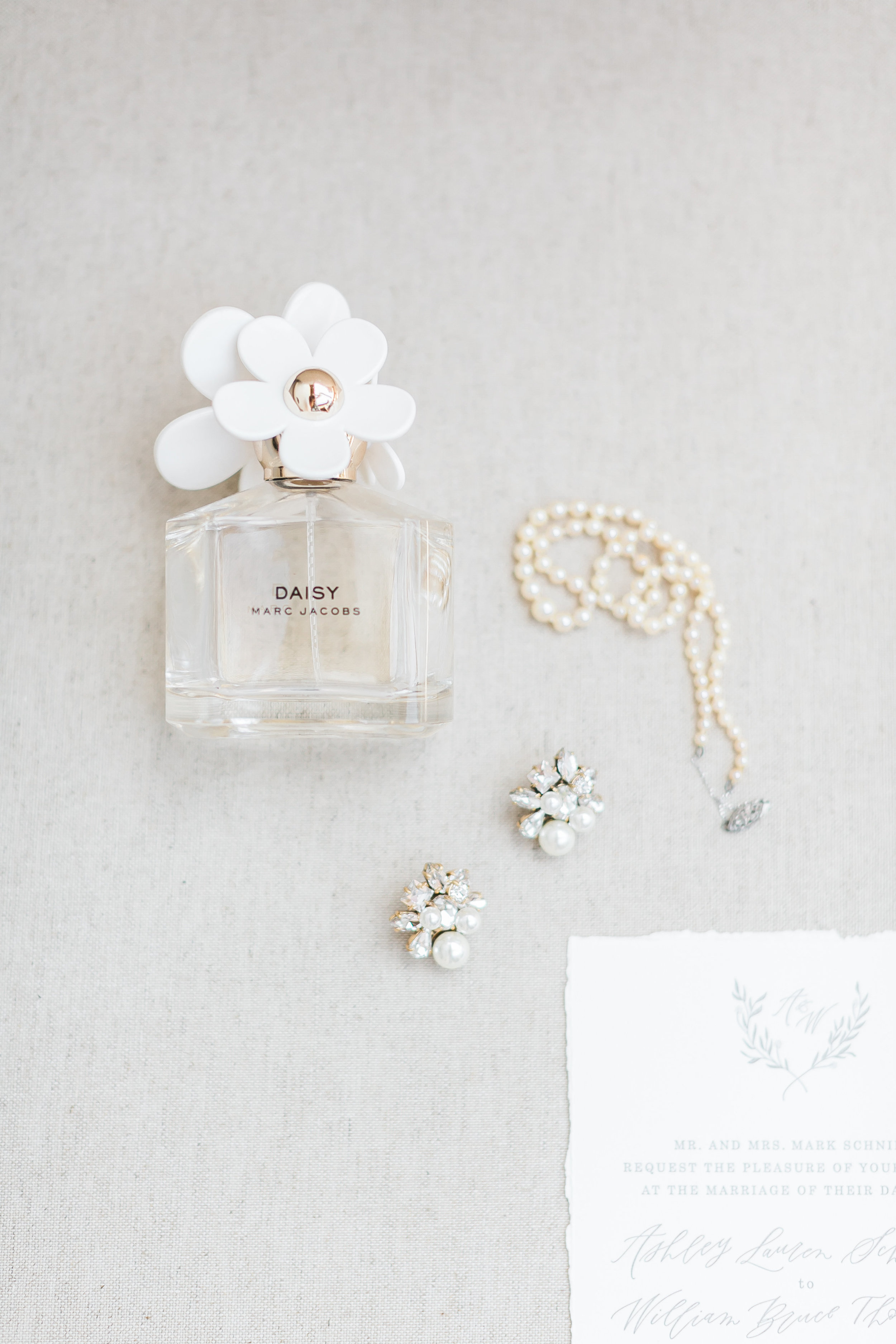Daisy Wedding Perfume.   CREDITS:  Destination Wedding Planner  ANDREA EPPOLITO EVENTS  · Images by  J.ANNE P  HOTOGRAPHY  · Video  HOO FILMS  · Venue Ritz Carlton Bacara Santa Barbara ·Gown  MONIQUE LHULLIER ·Bridesmaids Dresses  SHOW ME YOUR MUMU ·Stationery  SHE PAPERIE ·Bride's Shoes  BADGLEY MISCHKA ·Hair and Makeup  TEAM HAIR AND MAKEUP · Floral  BLUE MAGNOLIA ·Linen  LA TAVOLA ·Decor Rentals  TENT MERCHANT ·Calligraphy  EBB ·Lighting  FIVE STAR AV ·Ice Cream Station  MCCONNELL'S ICE CREAM