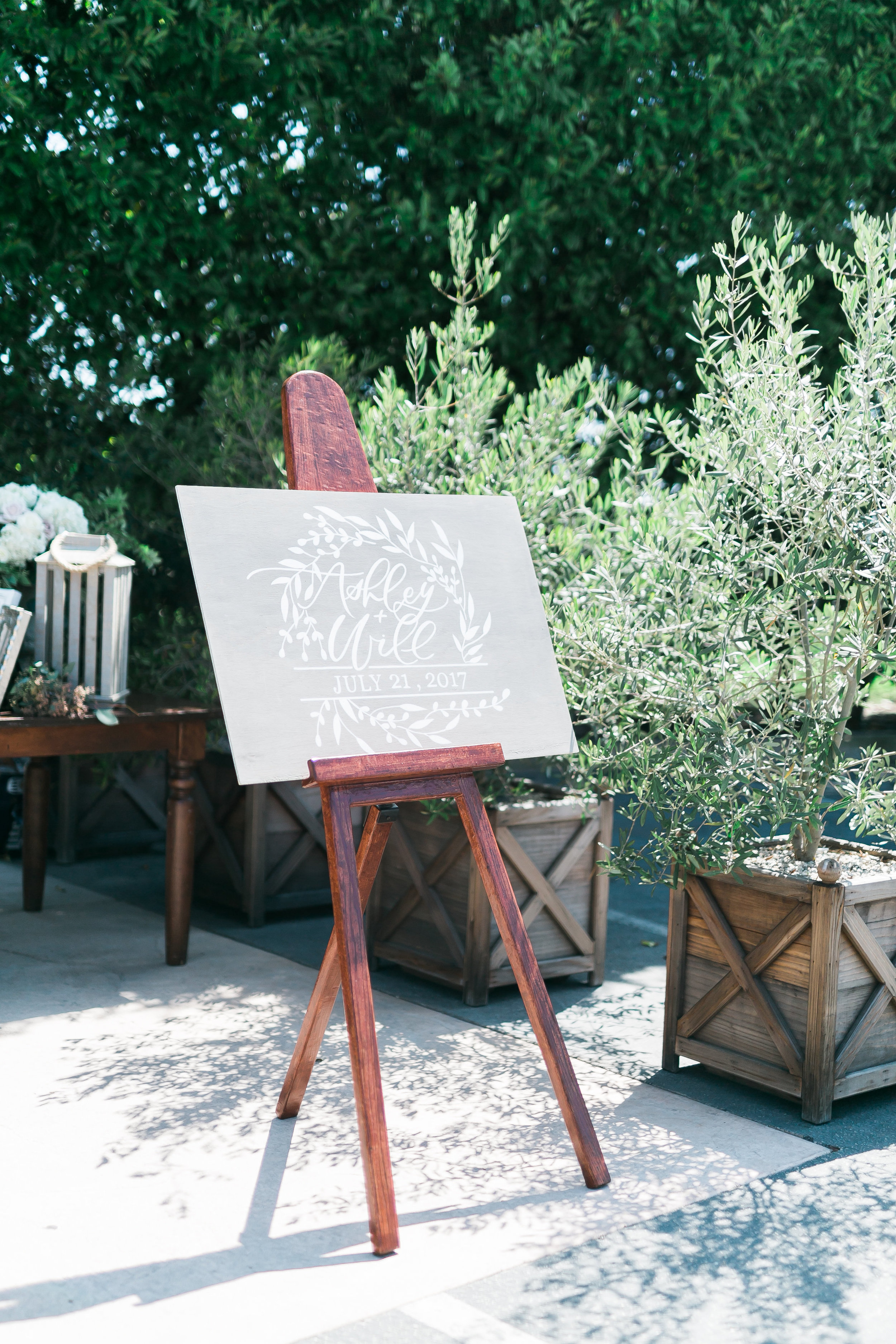 Wedding Welcome Sign.   CREDITS:  Destination Wedding Planner  ANDREA EPPOLITO EVENTS  · Images by  J.ANNE P  HOTOGRAPHY  · Video  HOO FILMS  · Venue Ritz Carlton Bacara Santa Barbara ·Gown  MONIQUE LHULLIER ·Bridesmaids Dresses  SHOW ME YOUR MUMU ·Stationery  SHE PAPERIE ·Bride's Shoes  BADGLEY MISCHKA ·Hair and Makeup  TEAM HAIR AND MAKEUP · Floral  BLUE MAGNOLIA ·Linen  LA TAVOLA ·Decor Rentals  TENT MERCHANT ·Calligraphy  EBB ·Lighting  FIVE STAR AV ·Ice Cream Station  MCCONNELL'S ICE CREAM