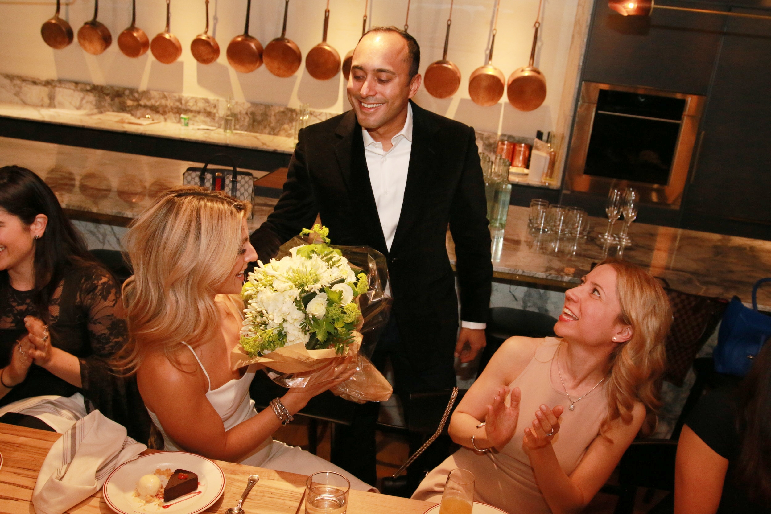 The groom brings his bride flowers at her shower. Destination Wedding Planner Andrea Eppolito is based in Las Vegas.