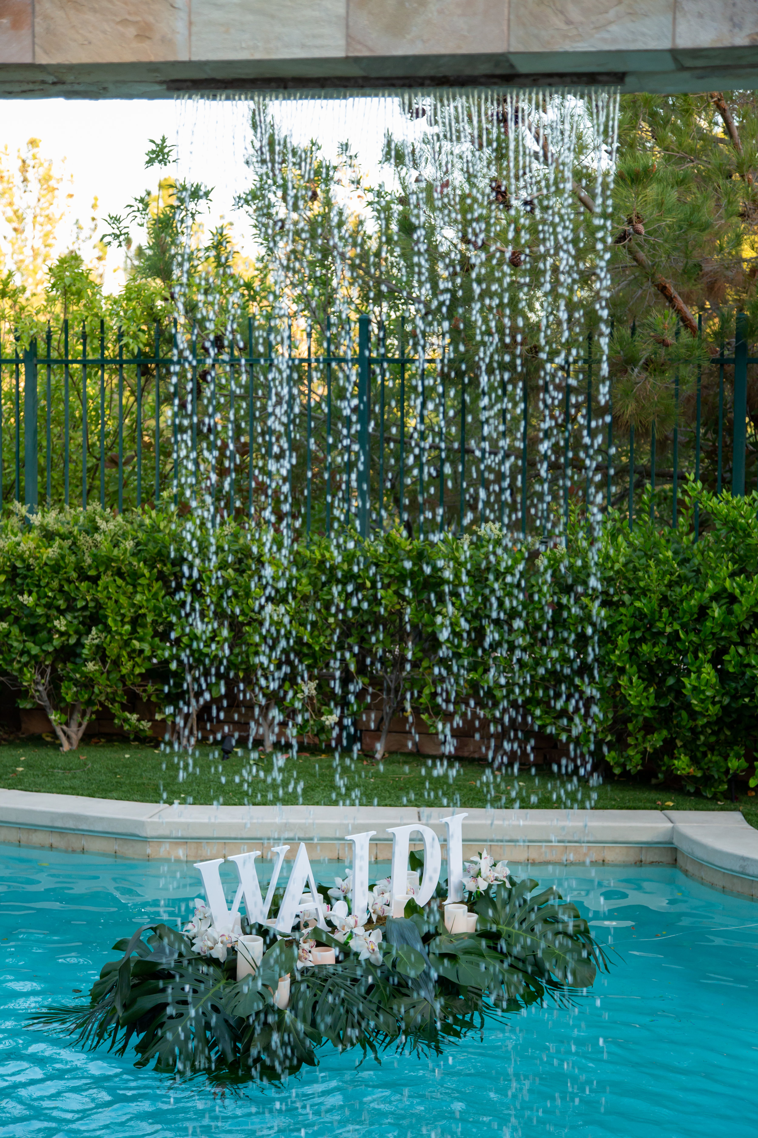 Don't forget the pool! Floating name and candles in the water were a custom touch.Las Vegas Event Planner Andrea Eppolito planned a Havana Nights Birthday Party for Pop Star Wajdi Kassas. By Dzign provided all decor, with lighting from LED UNplugged and photos by Adam Frazier.