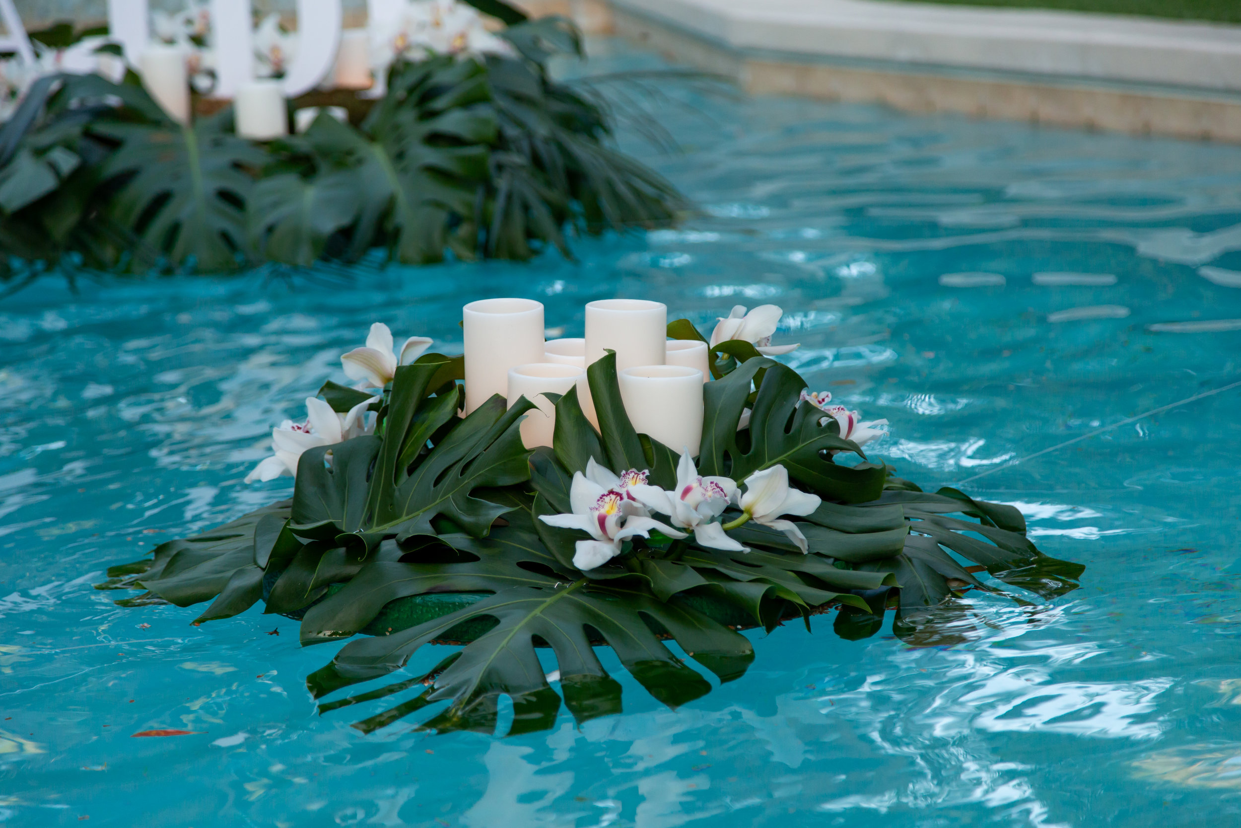 Floating greenery and candles.Las Vegas Event Planner Andrea Eppolito planned a Havana Nights Birthday Party for Pop Star Wajdi Kassas. By Dzign provided all decor, with lighting from LED UNplugged and photos by Adam Frazier.