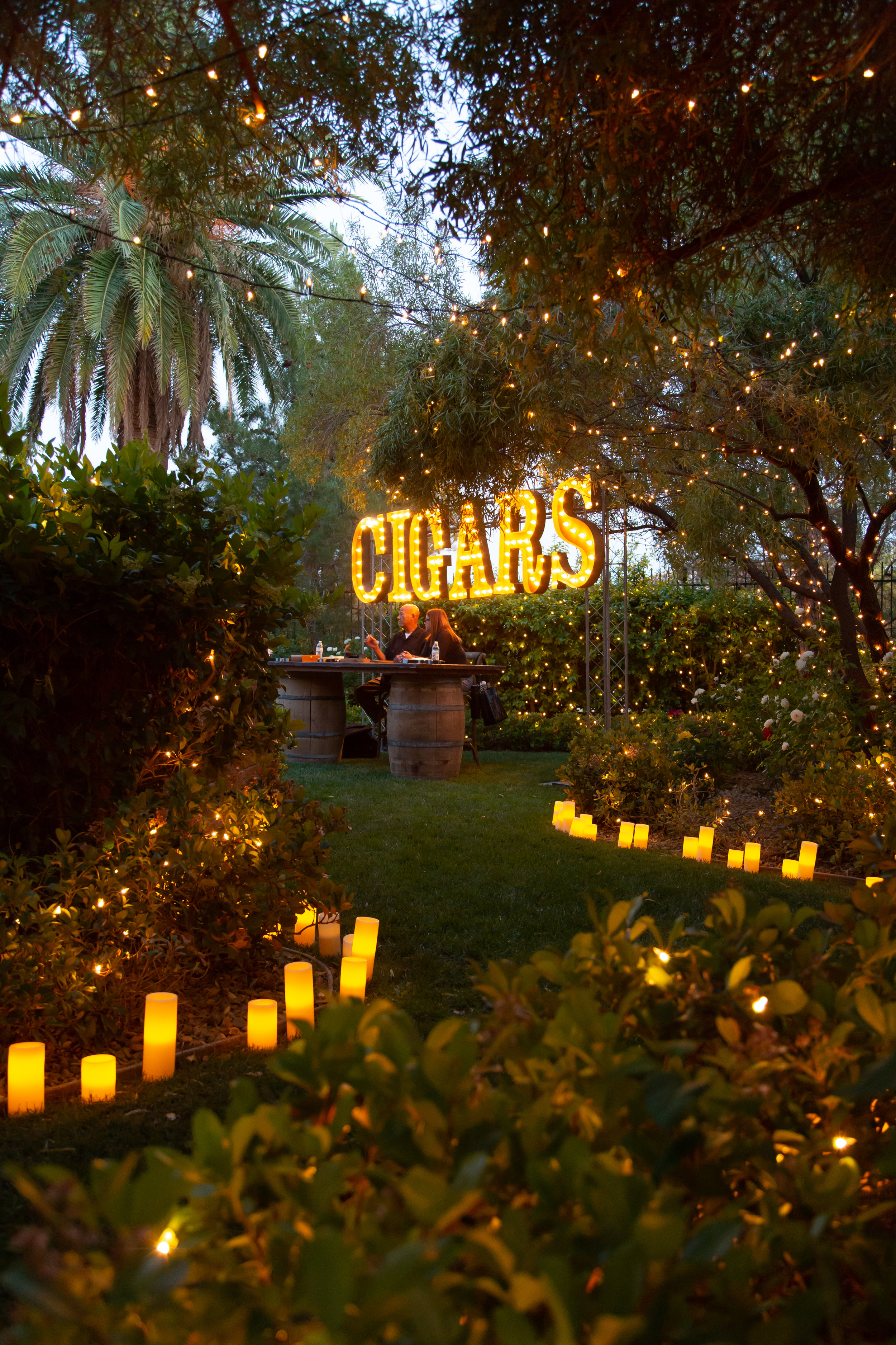 Twinkle lights and candles leading to the cigar station.Las Vegas Event Planner Andrea Eppolito planned a Havana Nights Birthday Party for Pop Star Wajdi Kassas. By Dzign provided all decor, with lighting from LED UNplugged and photos by Adam Frazier.