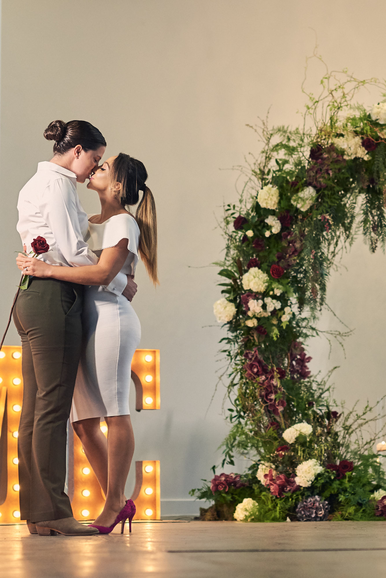 Lesbian Engagement Photos.  Las Vegas Wedding Planner Andrea Eppolito designed the surprise engagement at the Mandarin Oriental for two brides to be.  Decor and lighting by Flora Couture and LED Unplugged, with photos by Fabio and Adri.