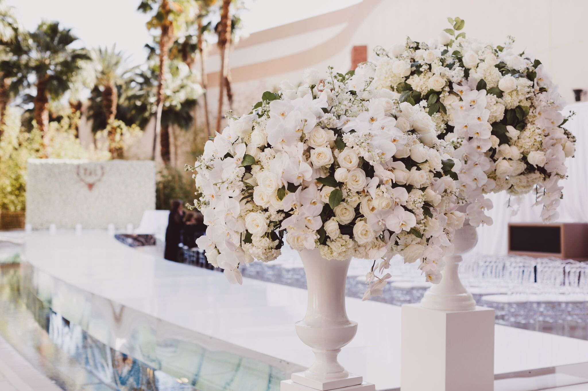 Big white flowers at an over the top wedding ceremony. Photo by Adam Trujillo.