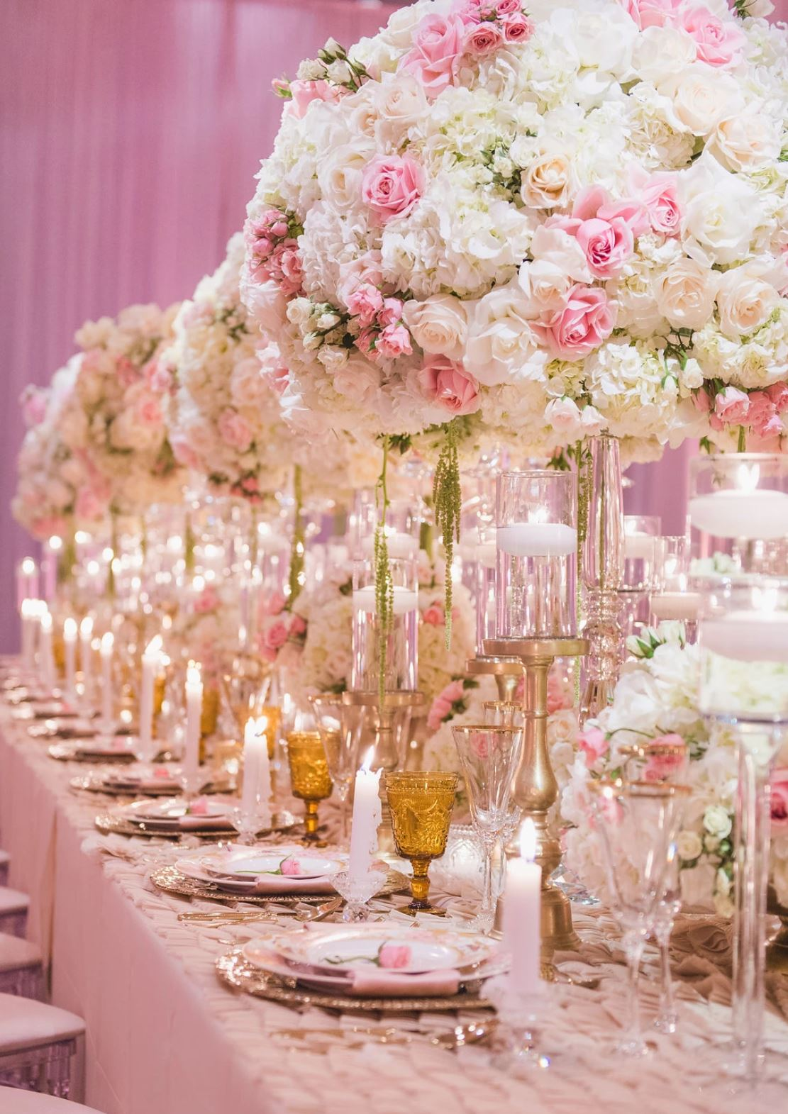 Pink and white wedding with tall centerpieces and gold accents. Photo by Chelsea Nicole.