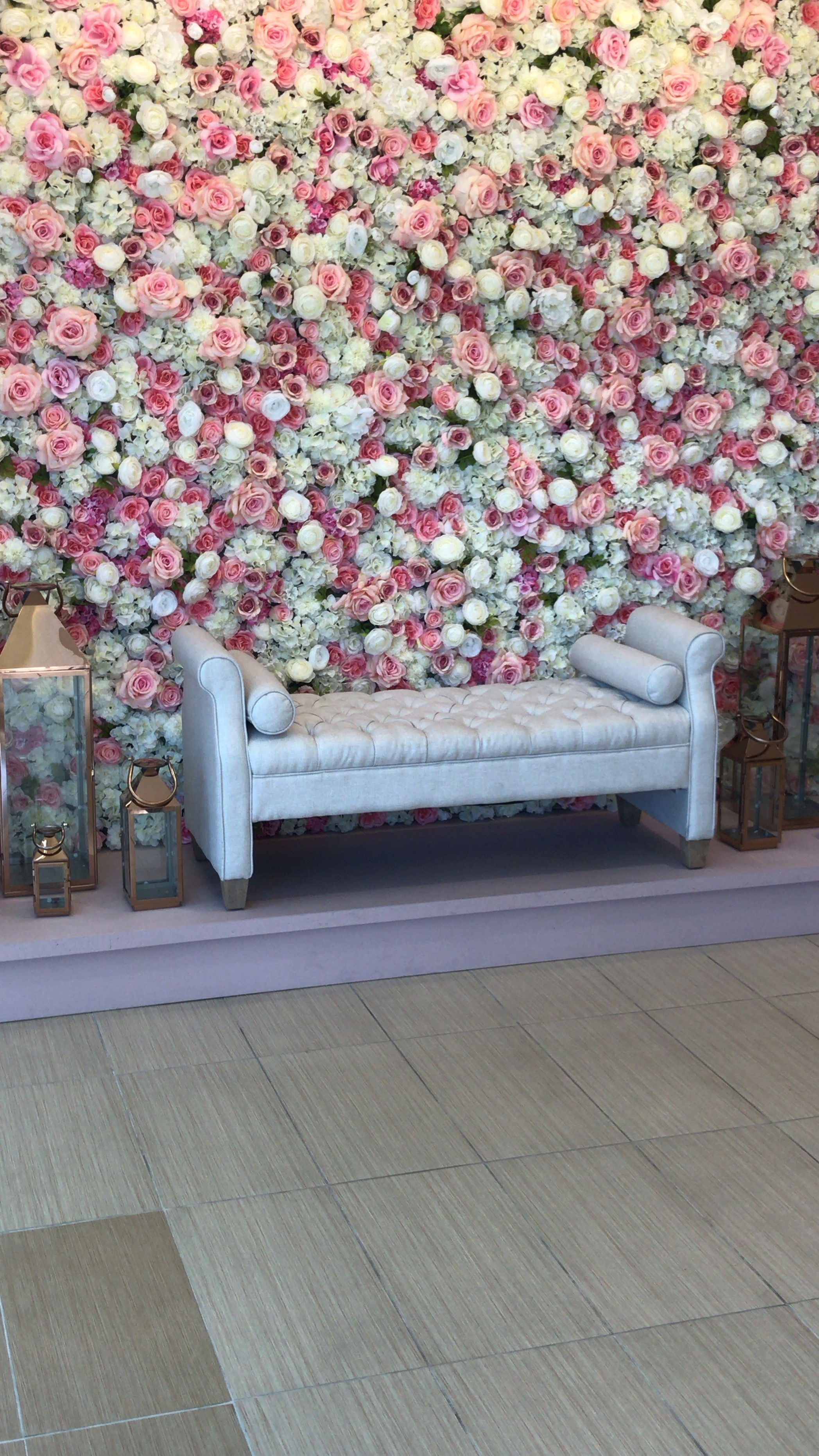 A floral wall makes for s great instagram moment at Javier Valentino.