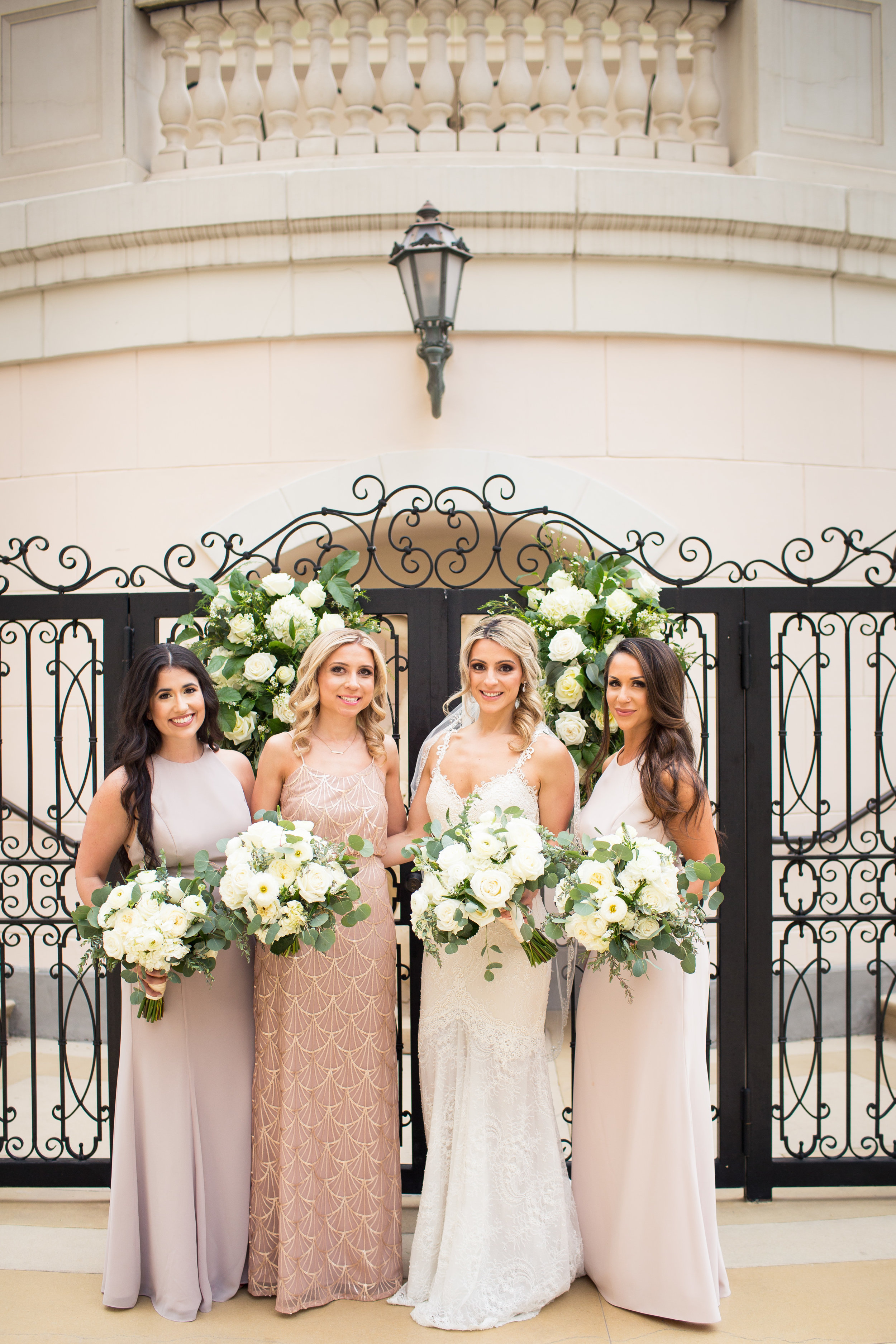 Bridal party in blush and champagne dresses.Wedding Planner:  Andrea Eppolito Events   | Photography  D2 Tuscan Wedding Photography  | Videography  M Place Productions  | Venue & Catering:  Bellagio  | Floral & Decor:  Destinations by Design  | Lighting:  LED Unplugged   | Music: Classical Entertainment &  DJ Mike Fox  | Hair & Make Up:  Amelia C & Co