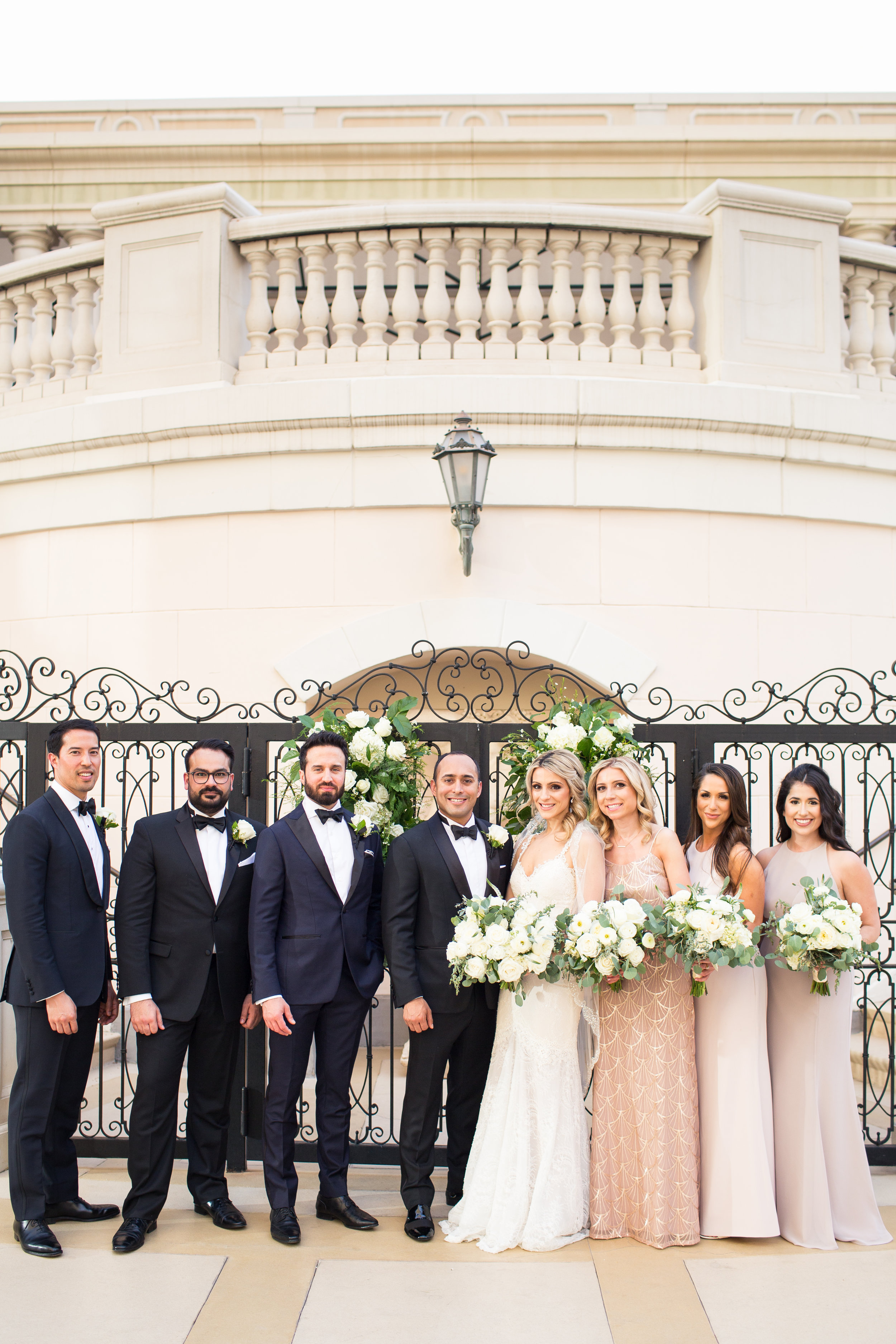 Bridal party in blush and black.Wedding Planner:  Andrea Eppolito Events   | Photography  D2 Tuscan Wedding Photography  | Videography  M Place Productions  | Venue & Catering:  Bellagio  | Floral & Decor:  Destinations by Design  | Lighting:  LED Unplugged   | Music: Classical Entertainment &  DJ Mike Fox  | Hair & Make Up:  Amelia C & Co