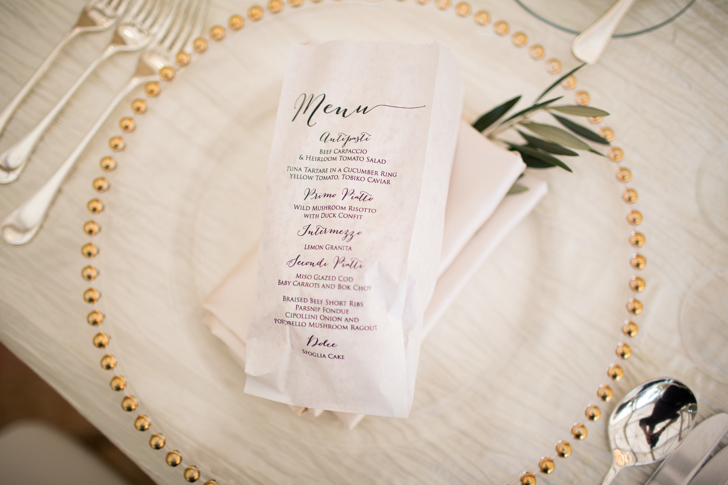 Bread bag with calligraphy menu on it.Wedding Planner:  Andrea Eppolito Events   | Photography  D2 Tuscan Wedding Photography  | Videography  M Place Productions  | Venue & Catering:  Bellagio  | Floral & Decor:  Destinations by Design  | Lighting:  LED Unplugged   | Music: Classical Entertainment &  DJ Mike Fox  | Hair & Make Up:  Amelia C & Co