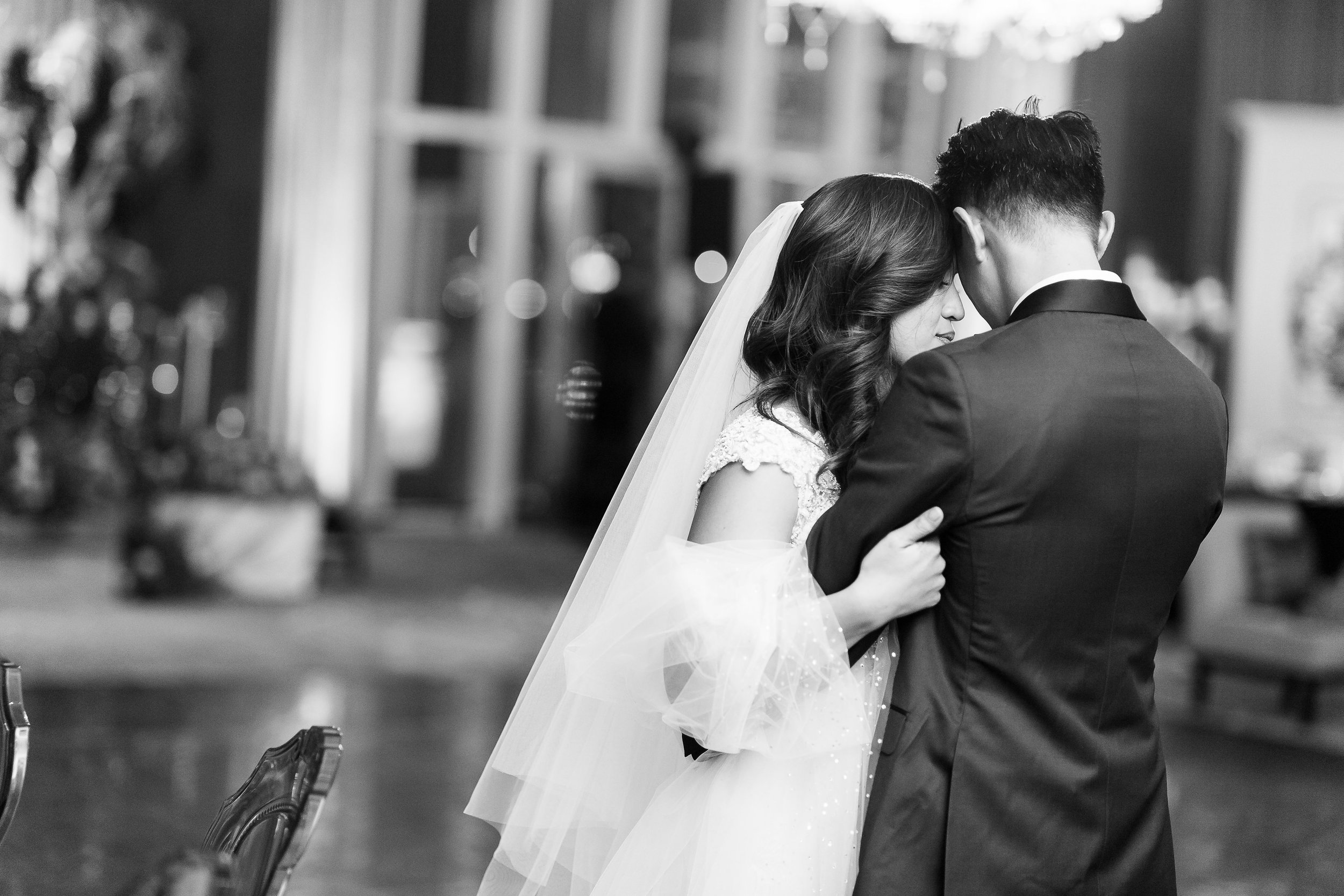Black and white photo of couple's first dance in Las Vegas.  Wedding Planner: Andrea Eppolito Events    Photography  Brian Leahy    Videography  HOO Films    Venue & Catering:  Mandarin Oriental  / Waldorf Astoria   Floral & Decor: Destinations by Design    Lighting: LED Unplugged    Music:  DJ Breeze II    Hair & Make Up: Amelia C & Co